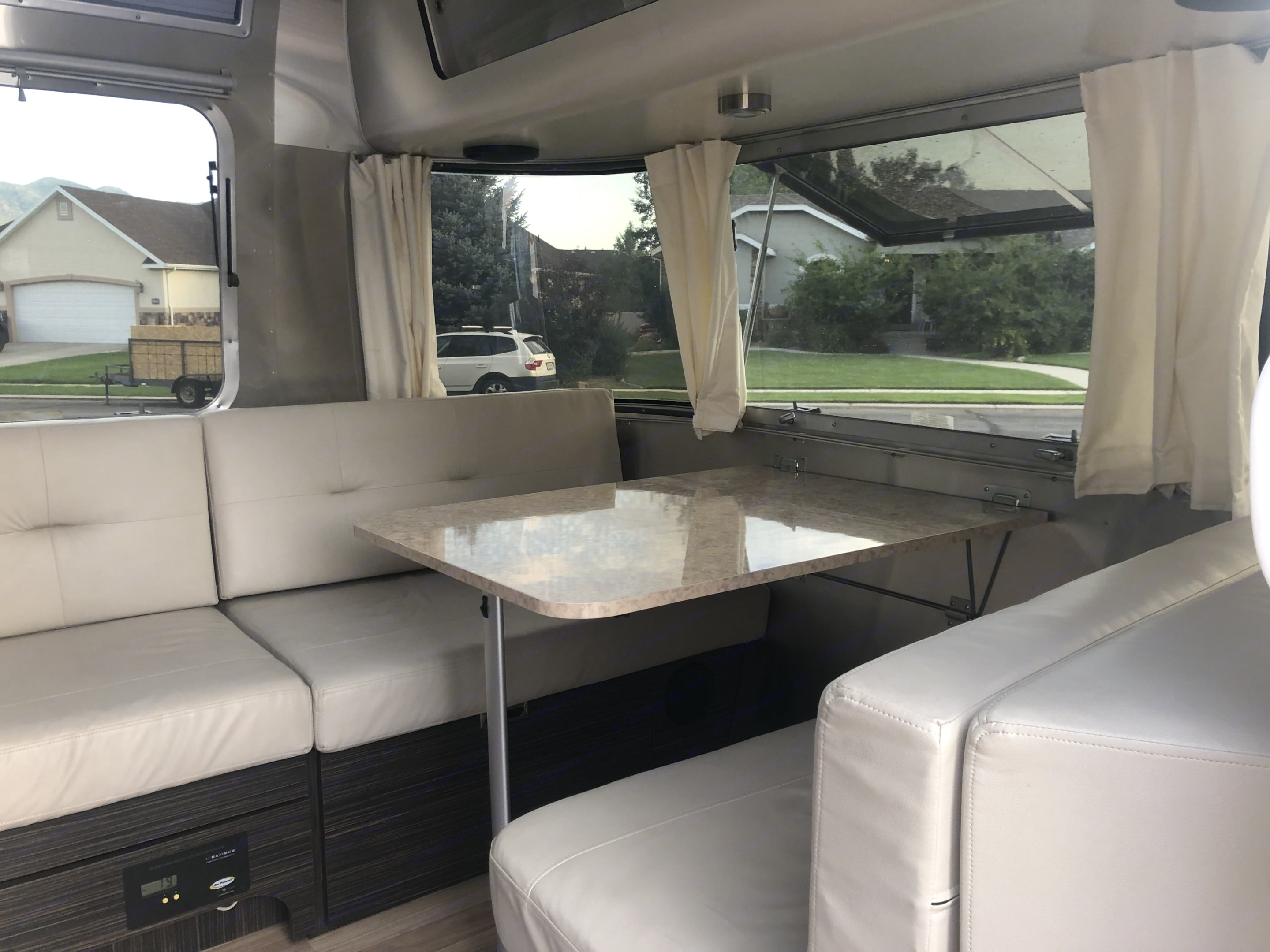 Front dinette makes into a bed that can sleep two.. Airstream International 2015