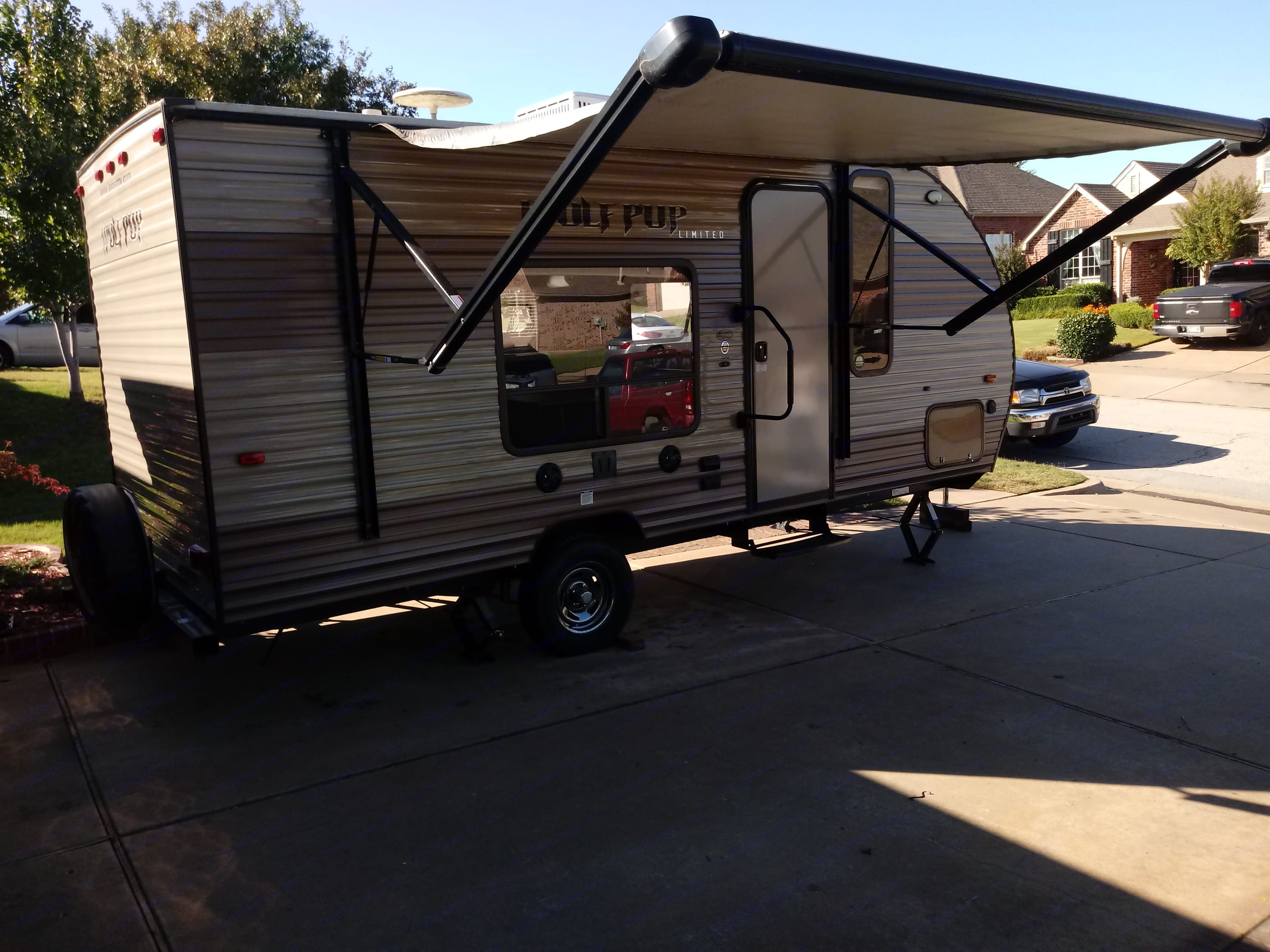 Awning extended, covers most of camper.  Big picture window by dinette area. . Forest River Cherokee Wolf Pup 2017