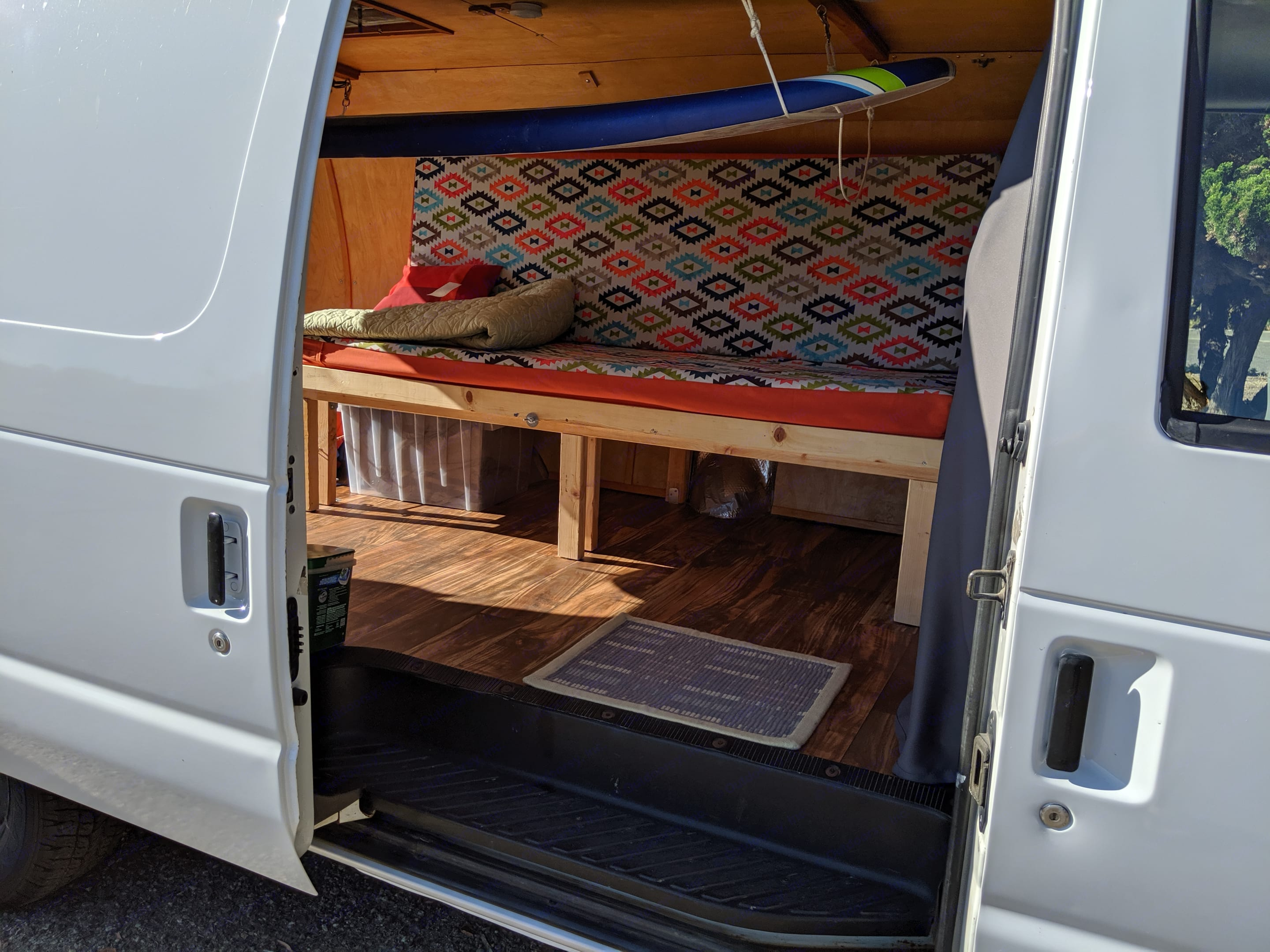 Bed in couch configuration. Surfboards can be securely hanged inside for quick loading/unloading.. Ford Econoline 150 2006
