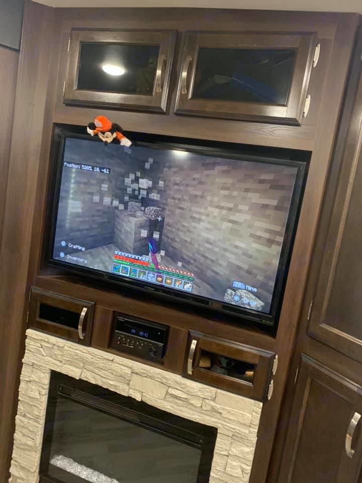 TV in the living room along with a fireplace to use on a chilly night!!. Jayco White Hawk 2019