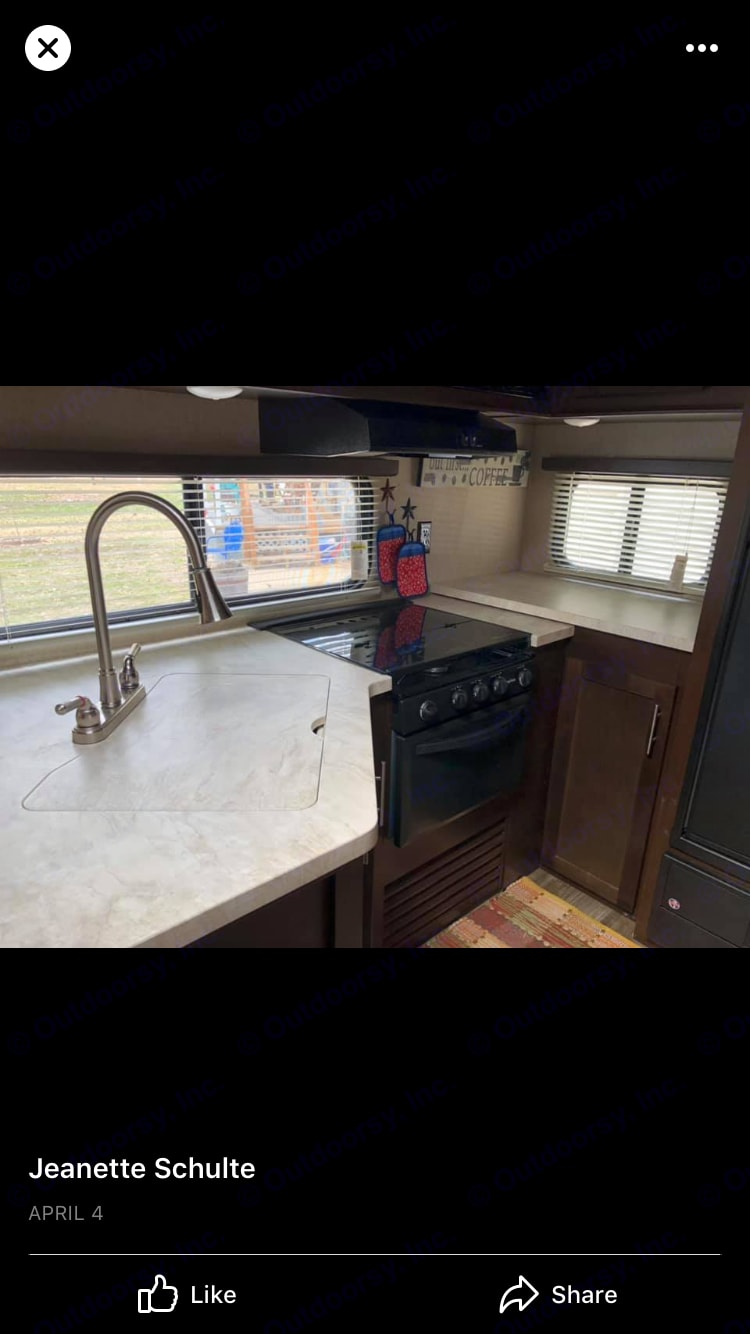 country style sink in L-shaped kitchen provides space for food prep. Forest River Cherokee 2016