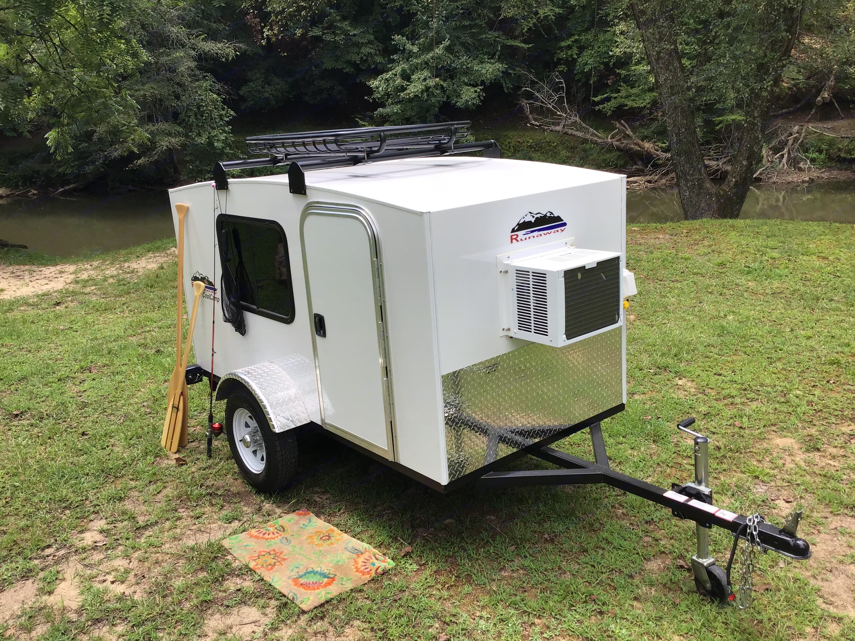 5,000 btu A/C Unit and 110v Power Connection with 6 Outlet Strip. Runaway Campers Coolcamp 2019