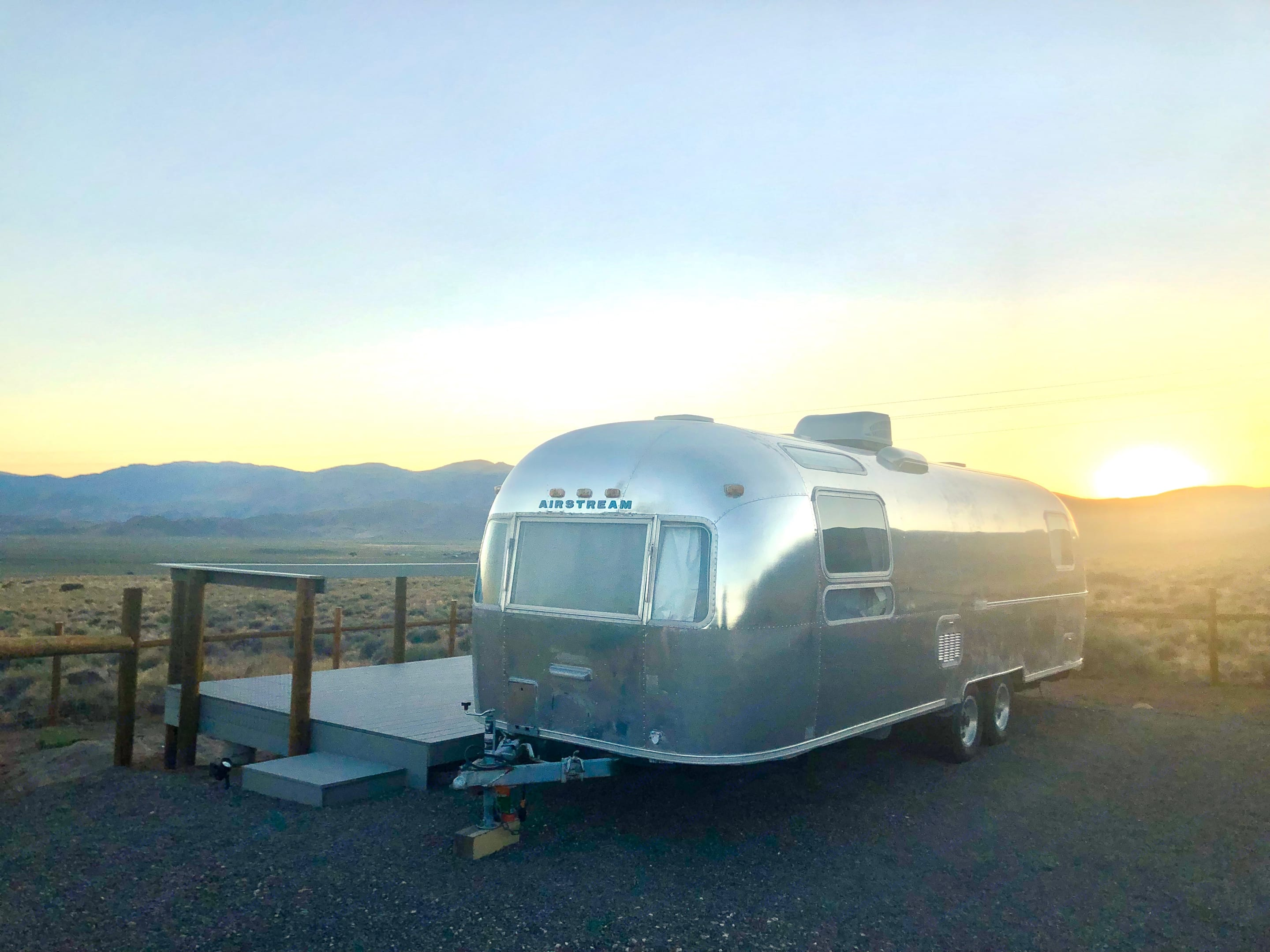 """Sun setting over the Airstream """"Chateau."""" . Airstream Land Yacht 1977"""