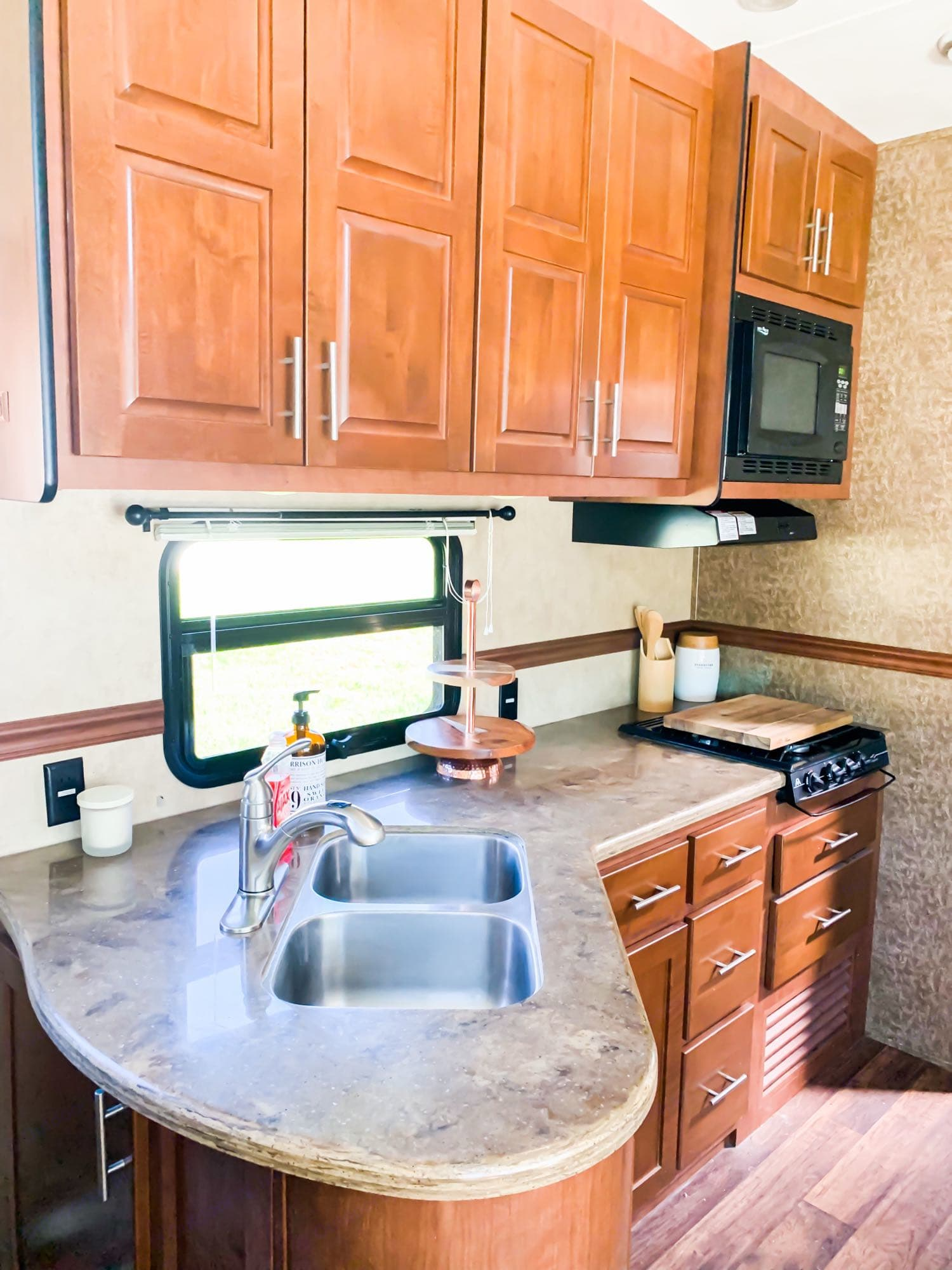 Kitchen with a lot of cabinet storage. Microwave/convection oven; propane stove👍. Dutchmen Komfort 2013