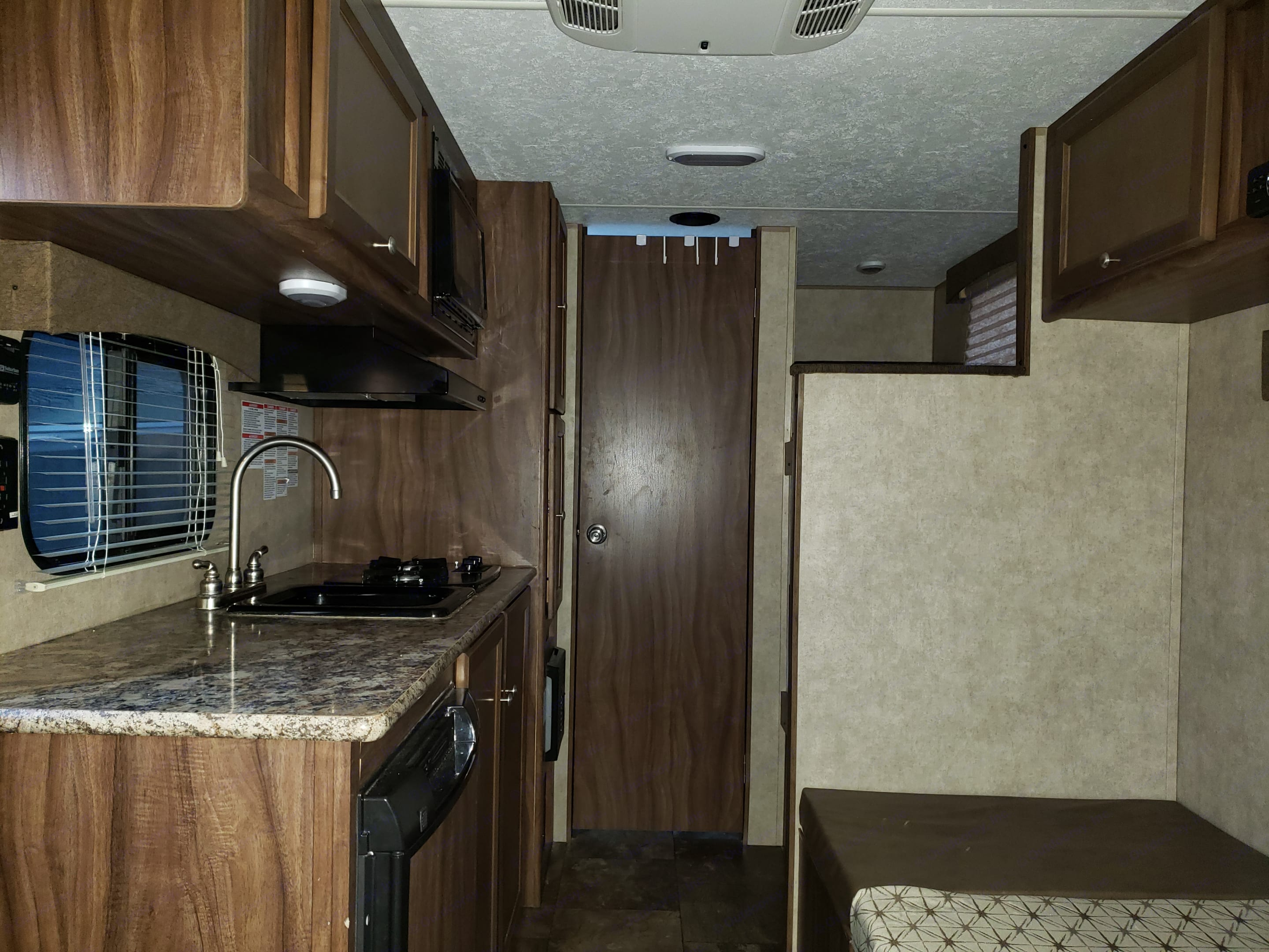 Kitchen and table converted to bed. Coachmen Viking 2015
