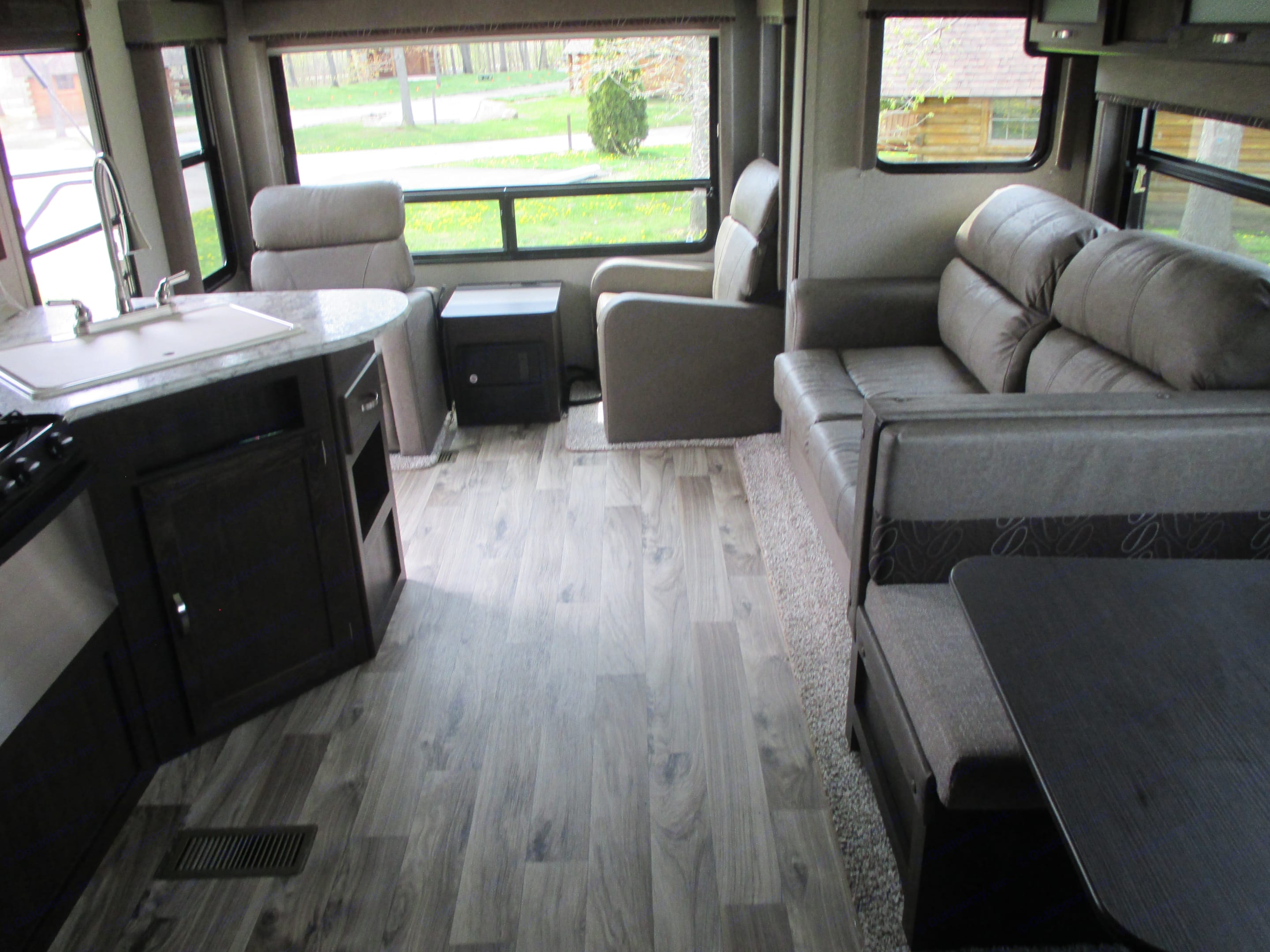 Slider opens up sitting area to picture window. Keystone Springdale 2018