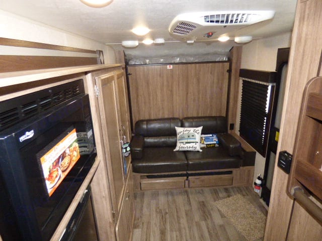 Comfortable couch that folds down into a queen size bed! . Jayco hummingbird 2019