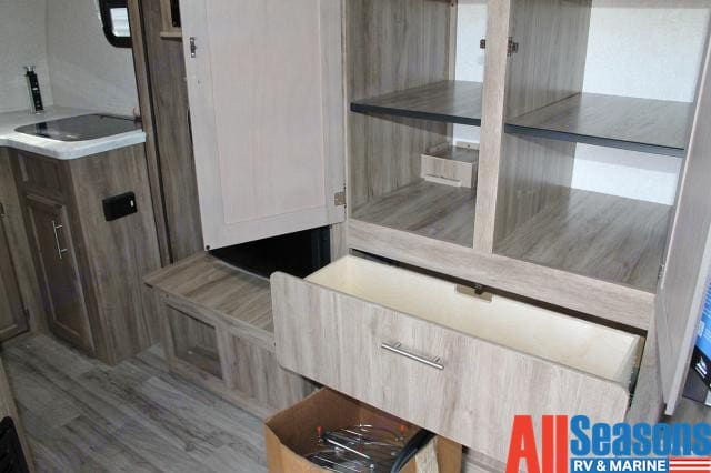 Cupboard and drawer space to store your food and clothing, also features as the slide out! . Jayco hummingbird 2019