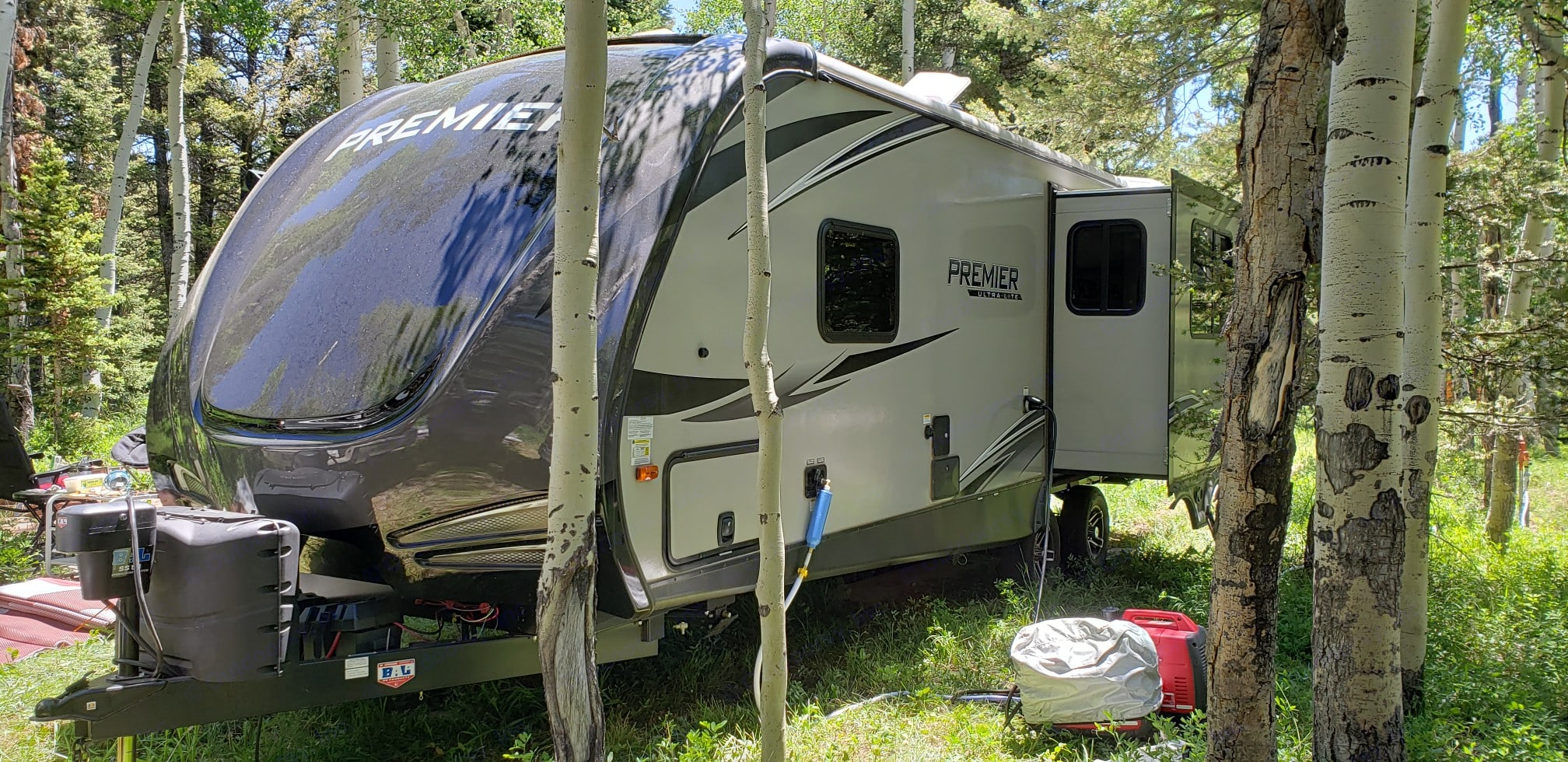 Three-quarter  view of the backside of our camper trailer.. Keystone Premier Ultra Lite 2019