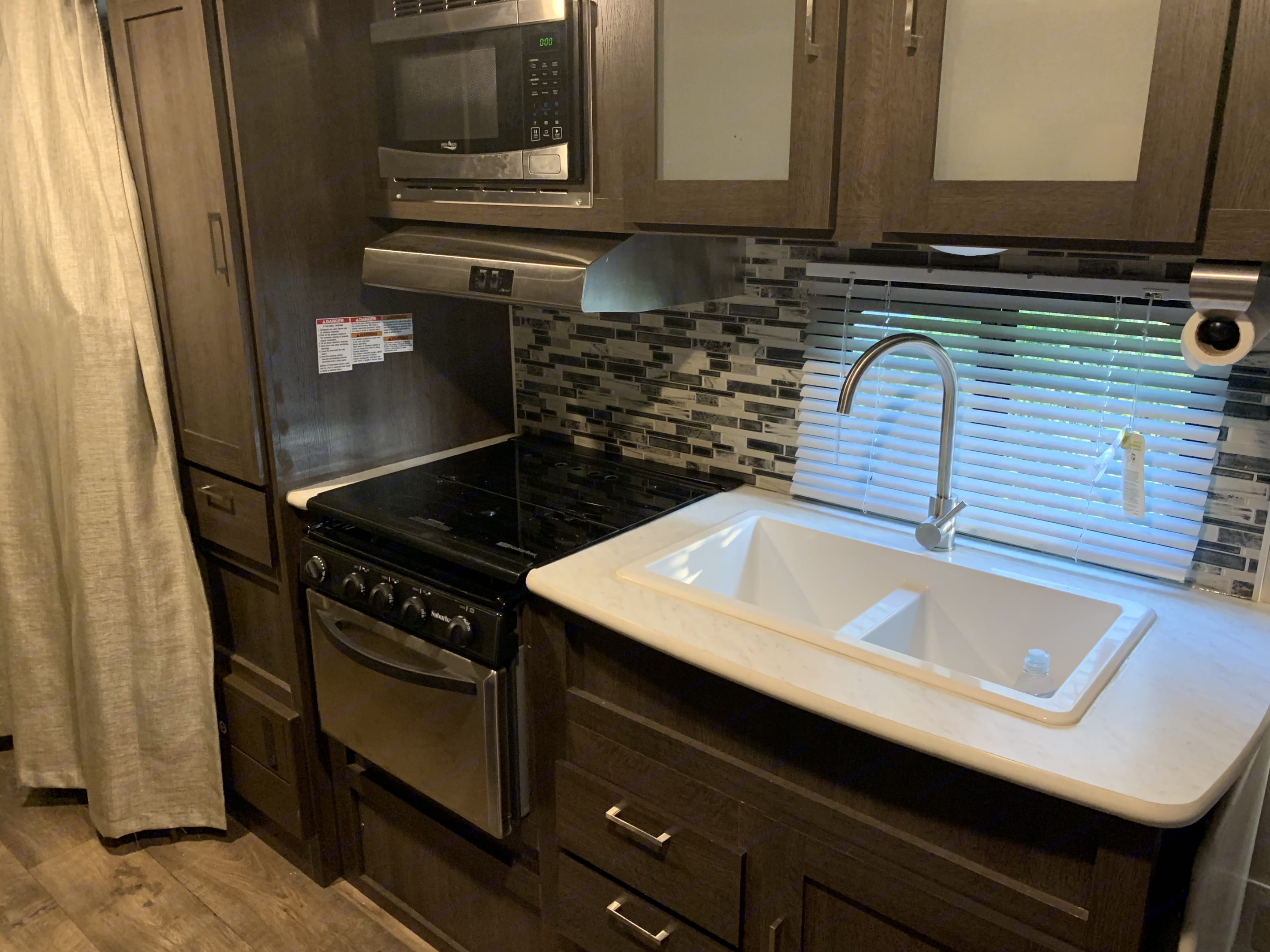 Kitchen area with double sink and range with oven.. Forest River Salem Cruise Lite 2018