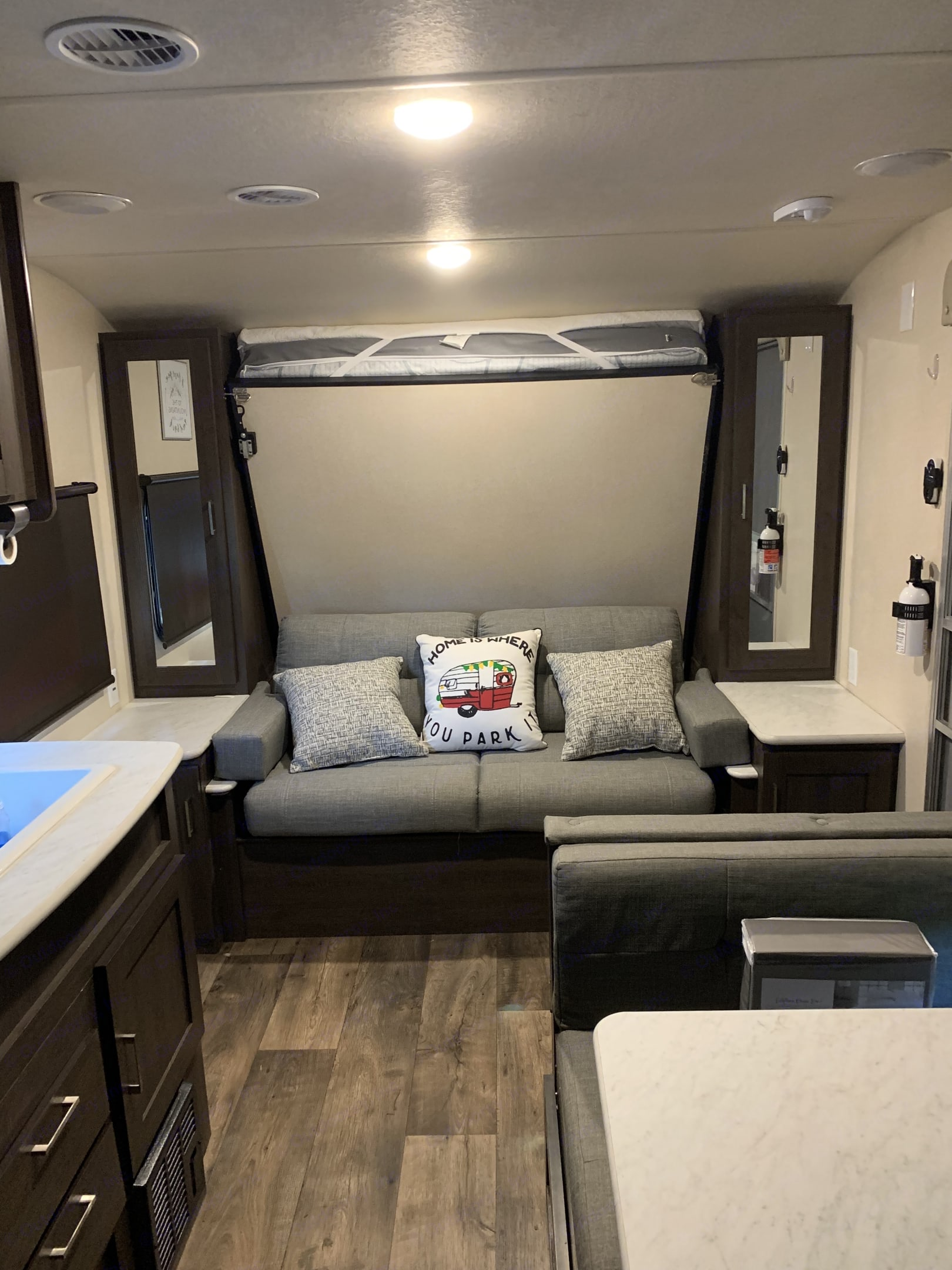 Folded up queen murphy bed with couch under neath.. Forest River Salem Cruise Lite 2018