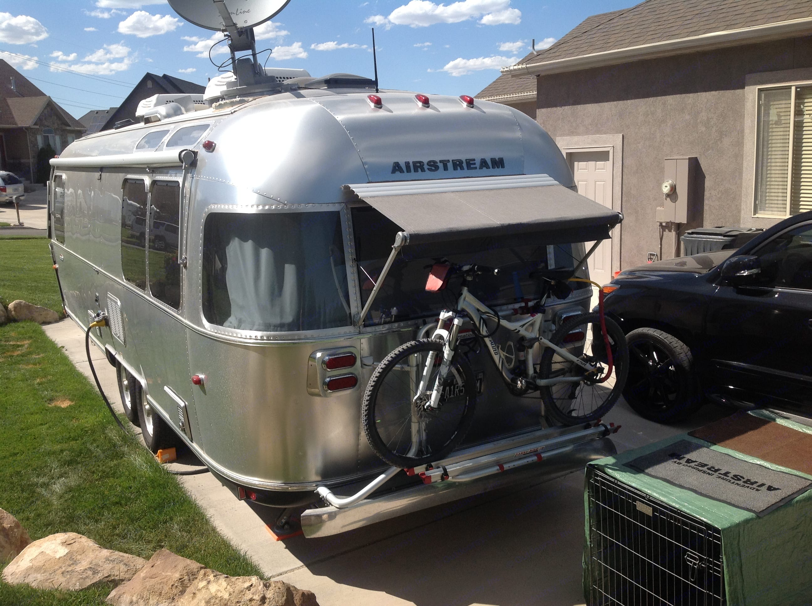 Exterior with bike rack and rear awning. Airstream International 2015