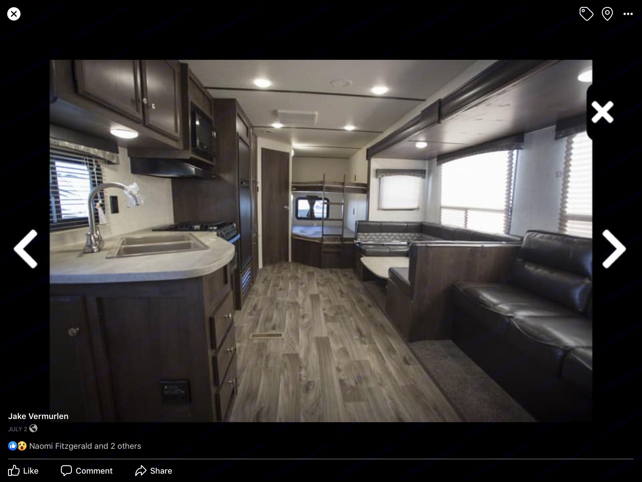 Large open floor plan with slide out. In back is the bathroom and Double sized bunks. Starcraft Autumn Ridge 2018