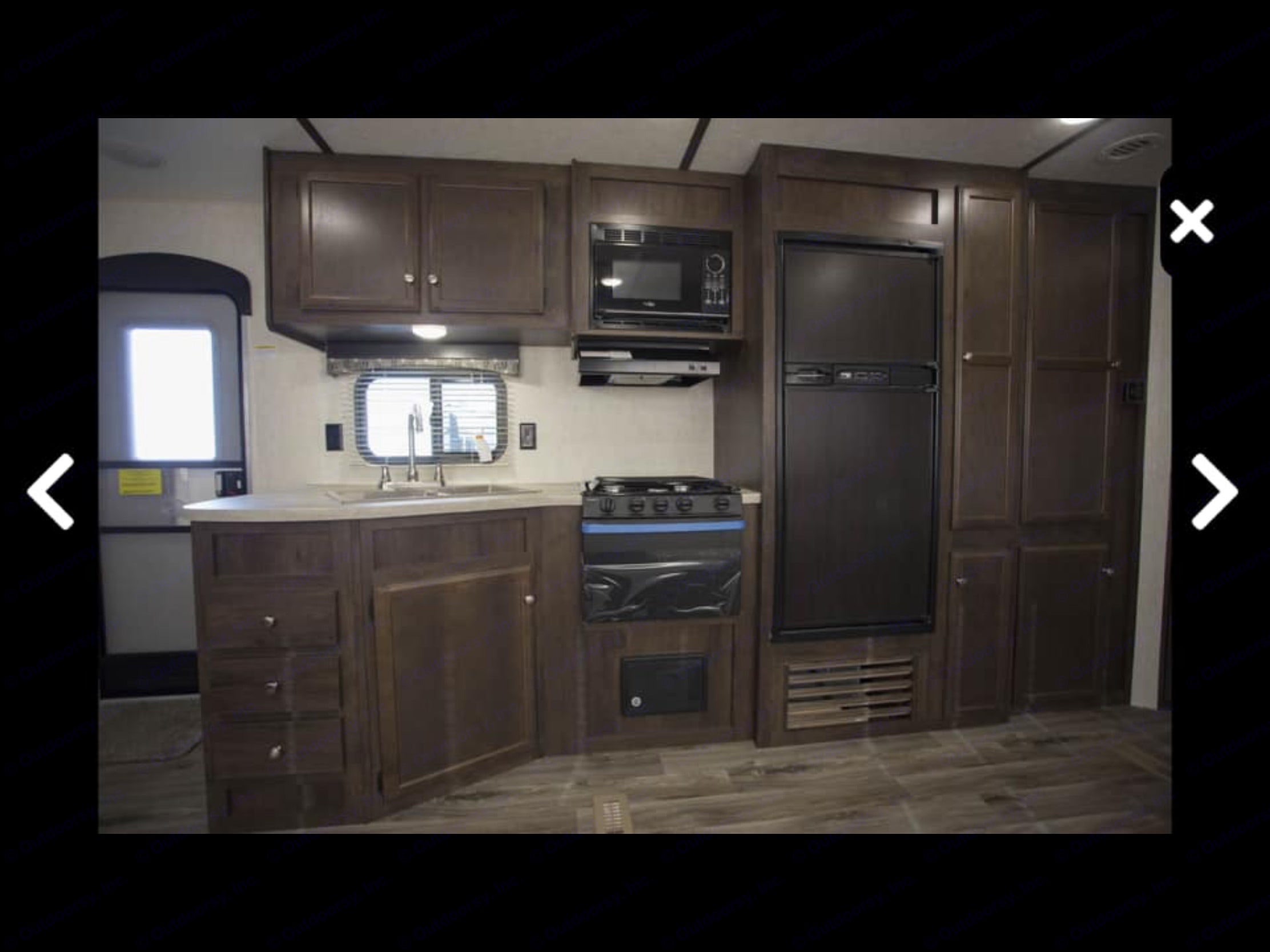 Kitchen are with stove, fridge and freezer along with a lot of storage.. Starcraft Autumn Ridge 2018