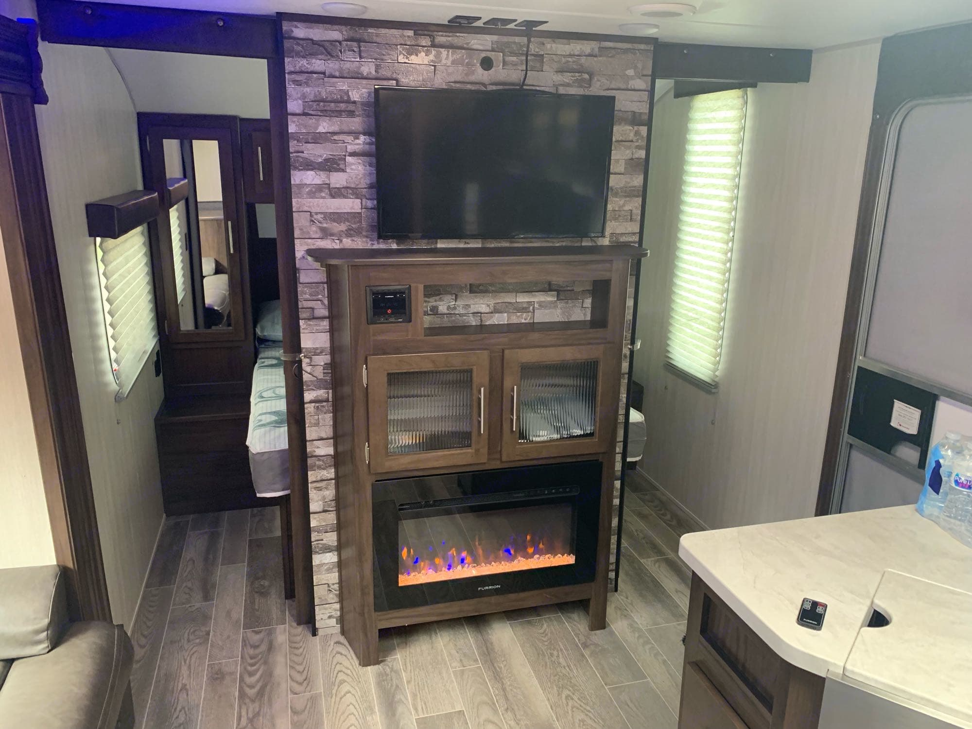 """32inch """"smart"""" HDTV with external Blu-ray /dvd player. Electric fireplace with flame look a puts out actual heat(if desired).. Forest River Cherokee Grey Wolf 2019"""