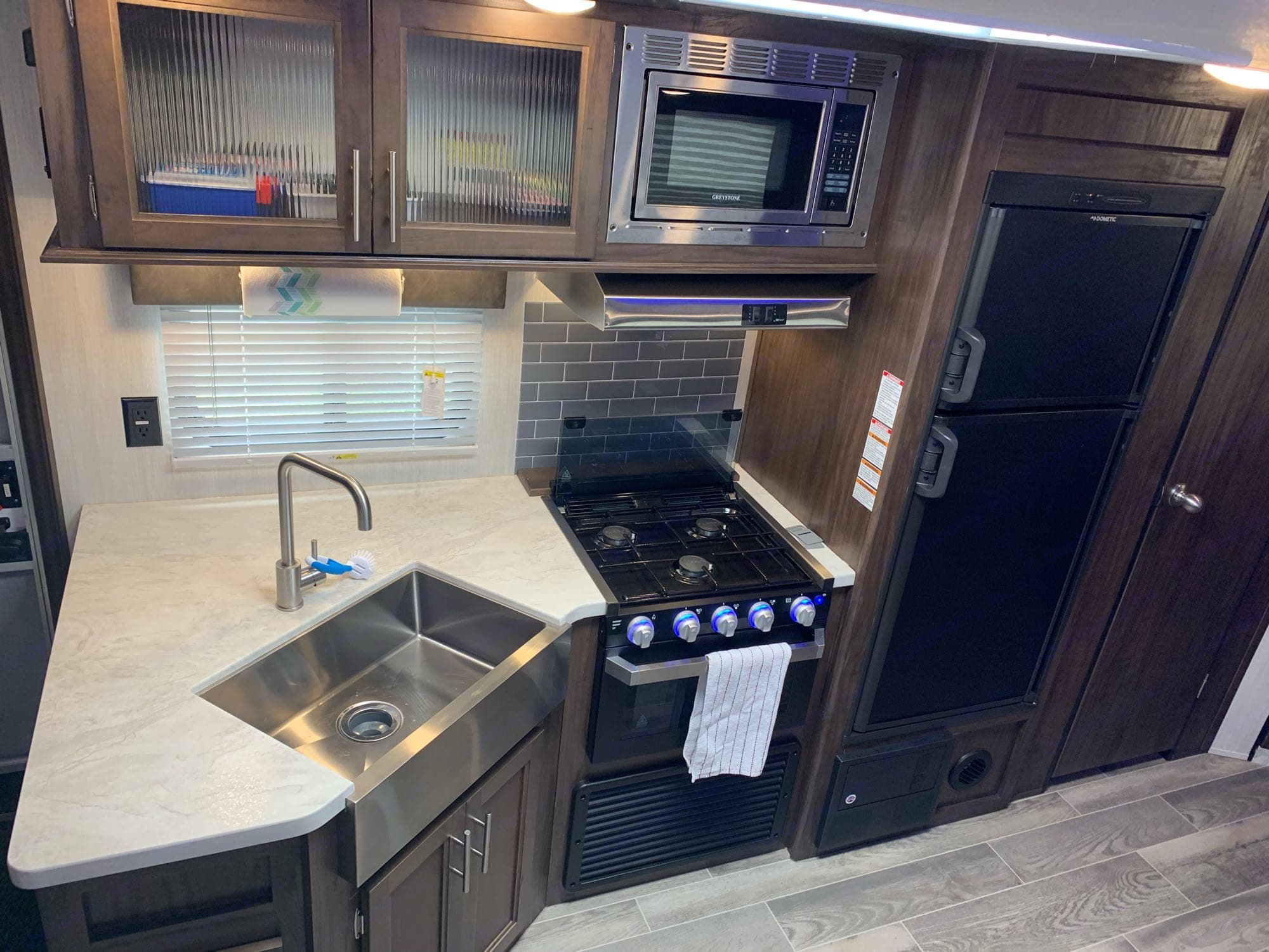 Spacious kitchen with farm house style sink, 3 burner stovetop, and oven.. Forest River Cherokee Grey Wolf 2019