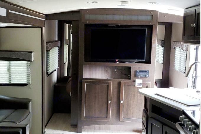 looking down center of trailer from bunk bed room, shown is TV and audio system wall unit, TV may be rotated to be viewd in master bedroom if desired.. Cruiser Rv Corp Shadow Cruiser 2018