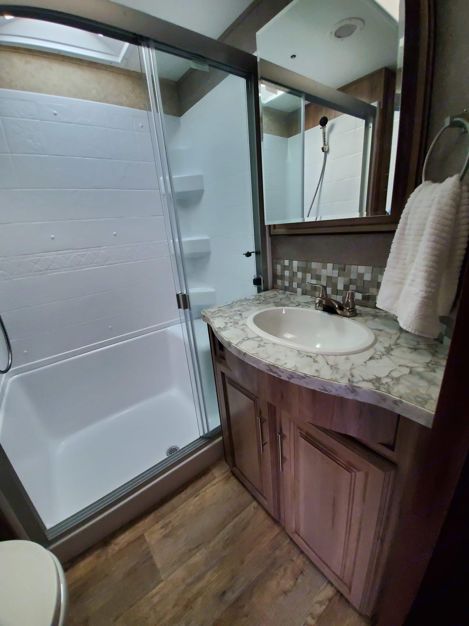 Main Bathroom: sink and shower. Jayco Eagle 347BHOK 2018