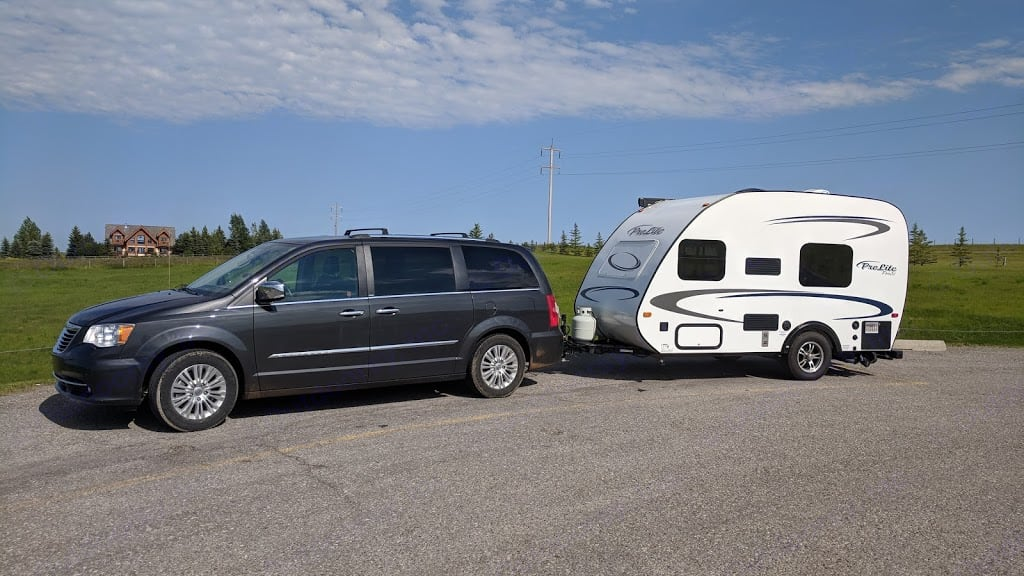 Top of the line Chrysler town and country limited edition with all leather heated seats, dual DVD, GPS.  Rent it to tow the Prolite RV in the picture for a great trip to the Rockies !. chrysler town and country 2012