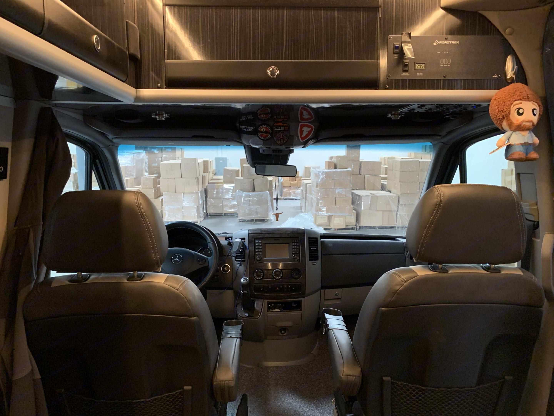 Cockpit view. We swivel the passenger seat rearward for more interior seating when parked. Roadtrek RS E-Trek 2018