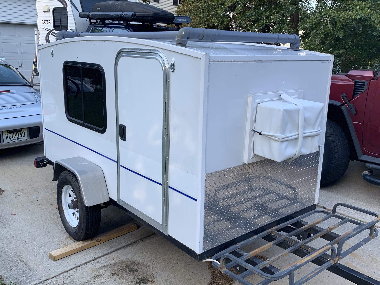 The camper has racks for your gear.. Runaway Campers Runaway 2014