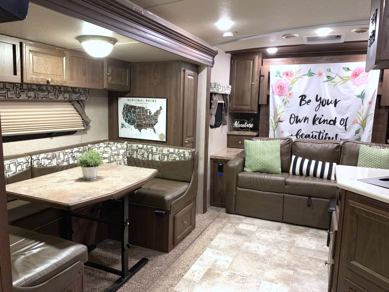 Comfy sofa and U-shaped dinette provide plenty of seating room. Forest River Rockwood Mini Lite 2017