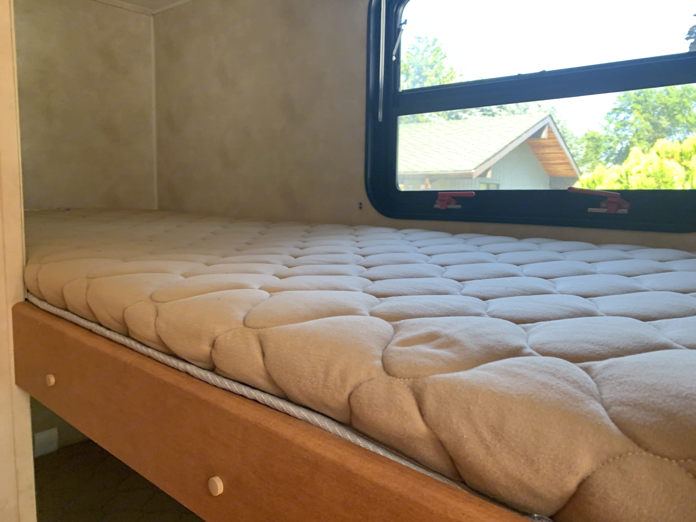 single over single bunk beds. Forest River Puma 2012