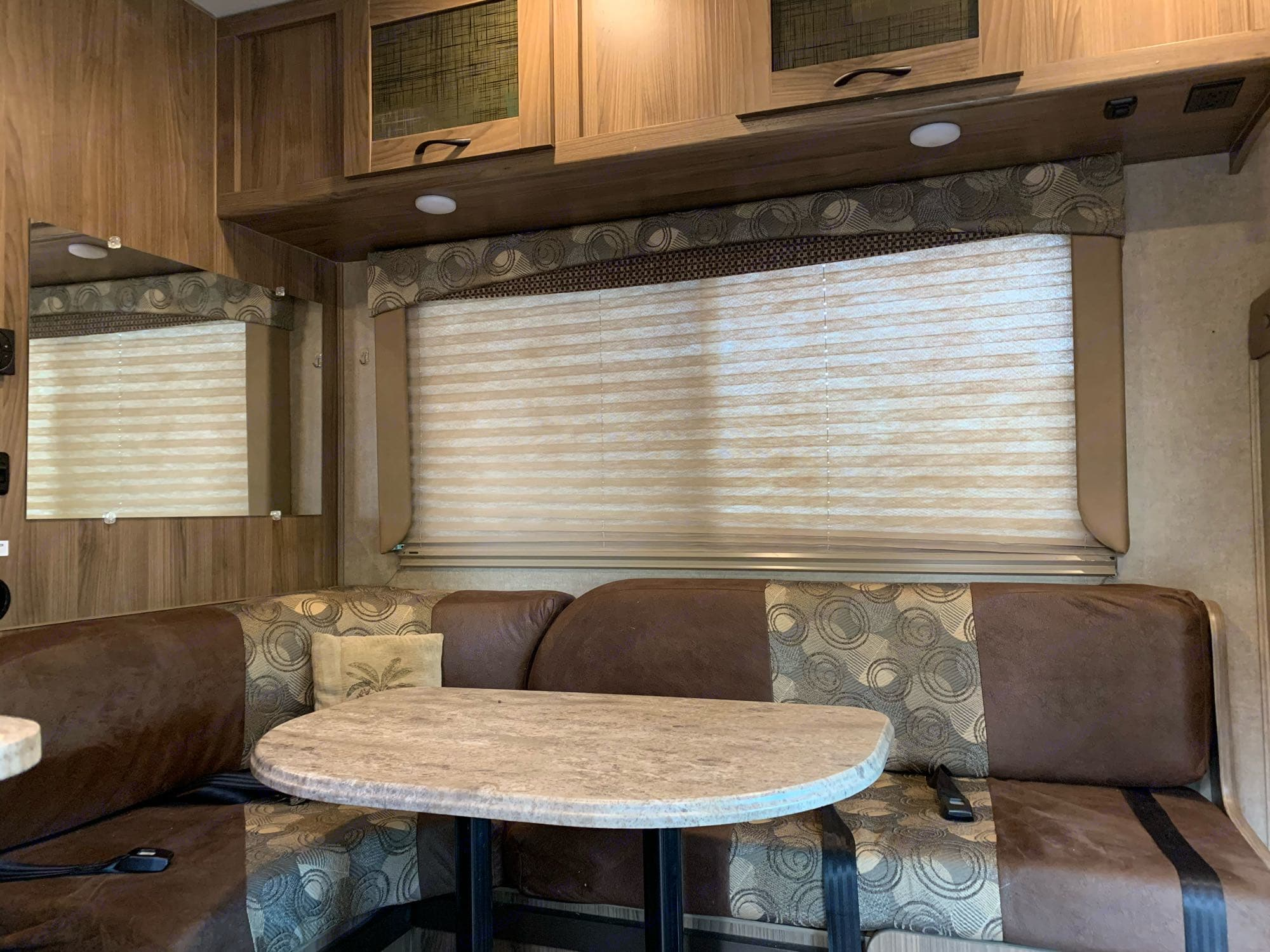 dining table with slid-out extra seat converts to small bed. Coachmen Freelander 2016