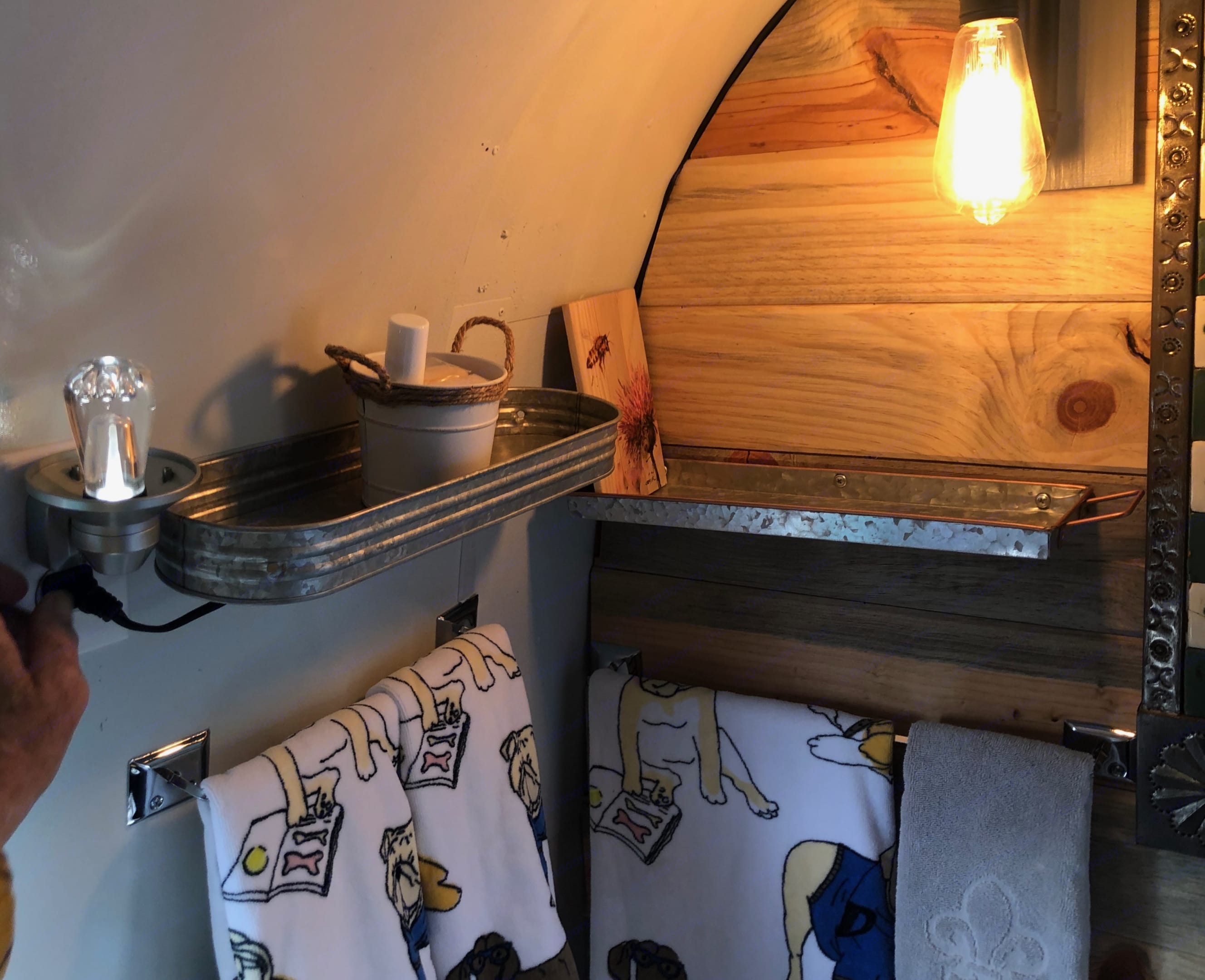 Beautiful stainless bath with shower, soaps & amenities. Airstream Land Yacht 1977