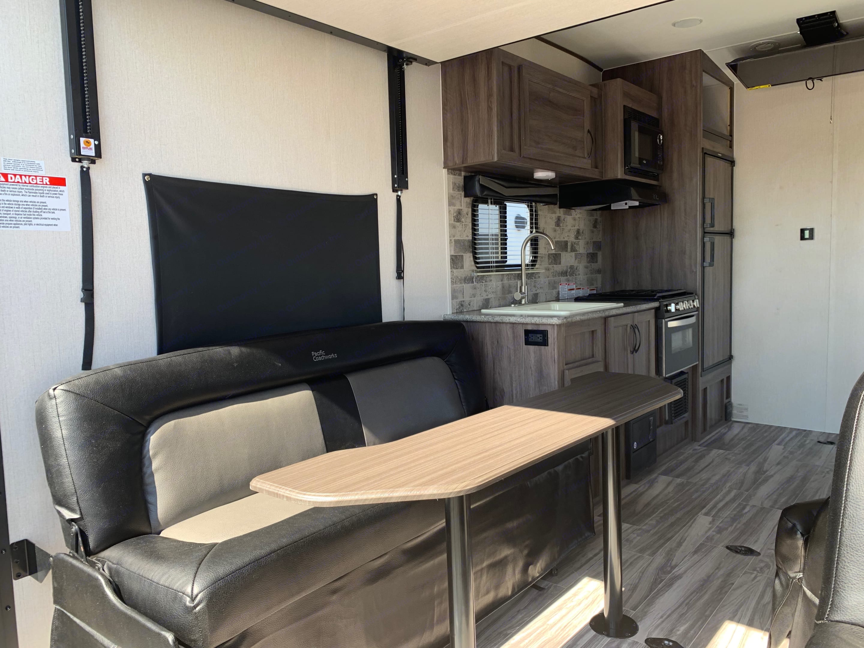 Movable captain chairs, rear electric bed, fold-able coach creating comfortable sleeping arrangements for your entire crew.. Pacific Coachworks Sandsport 2020