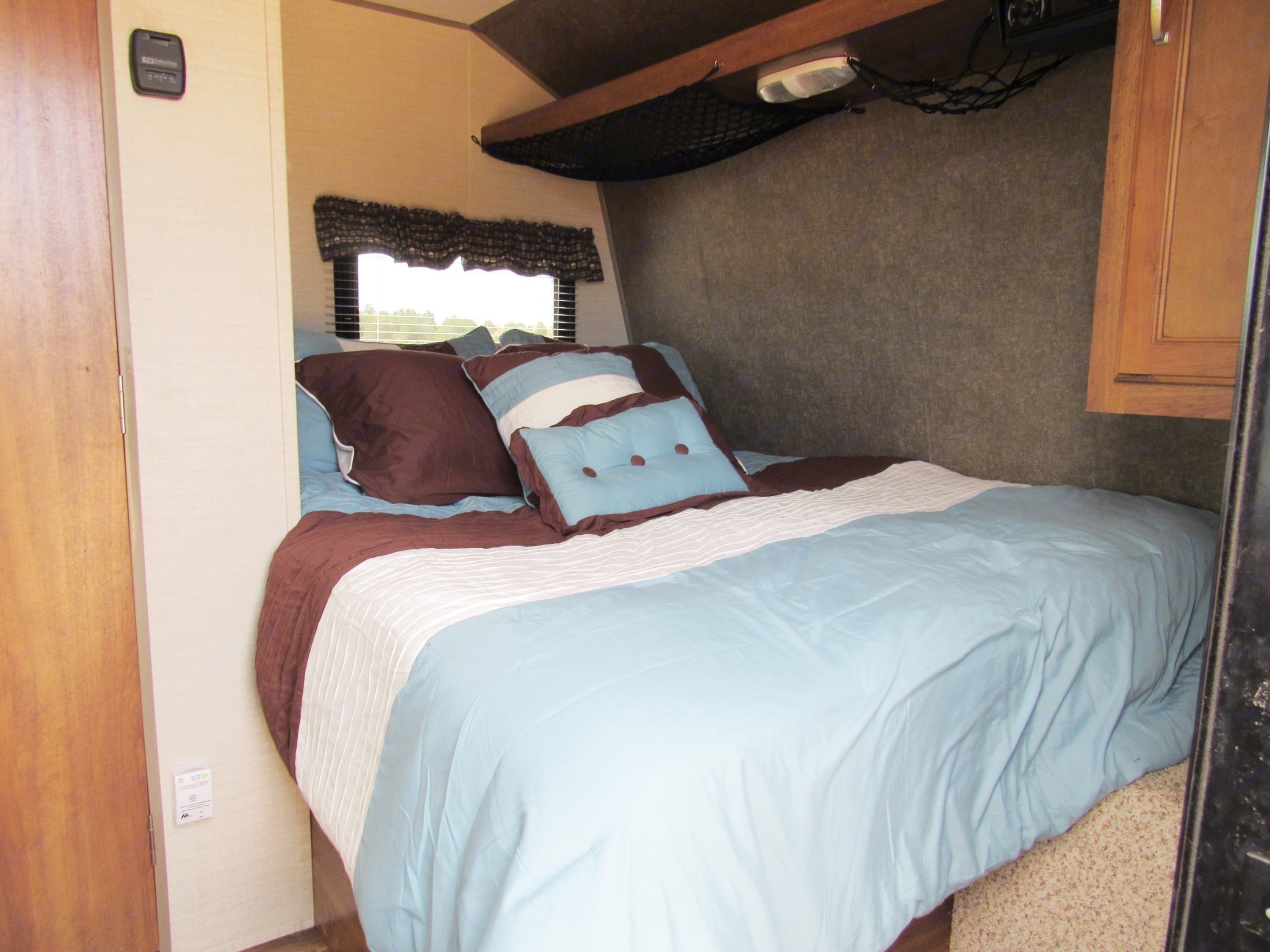 Queen bed with memory foam topper.  Sheets, pillows, and a blanket are included.. Keystone Summerland 2017