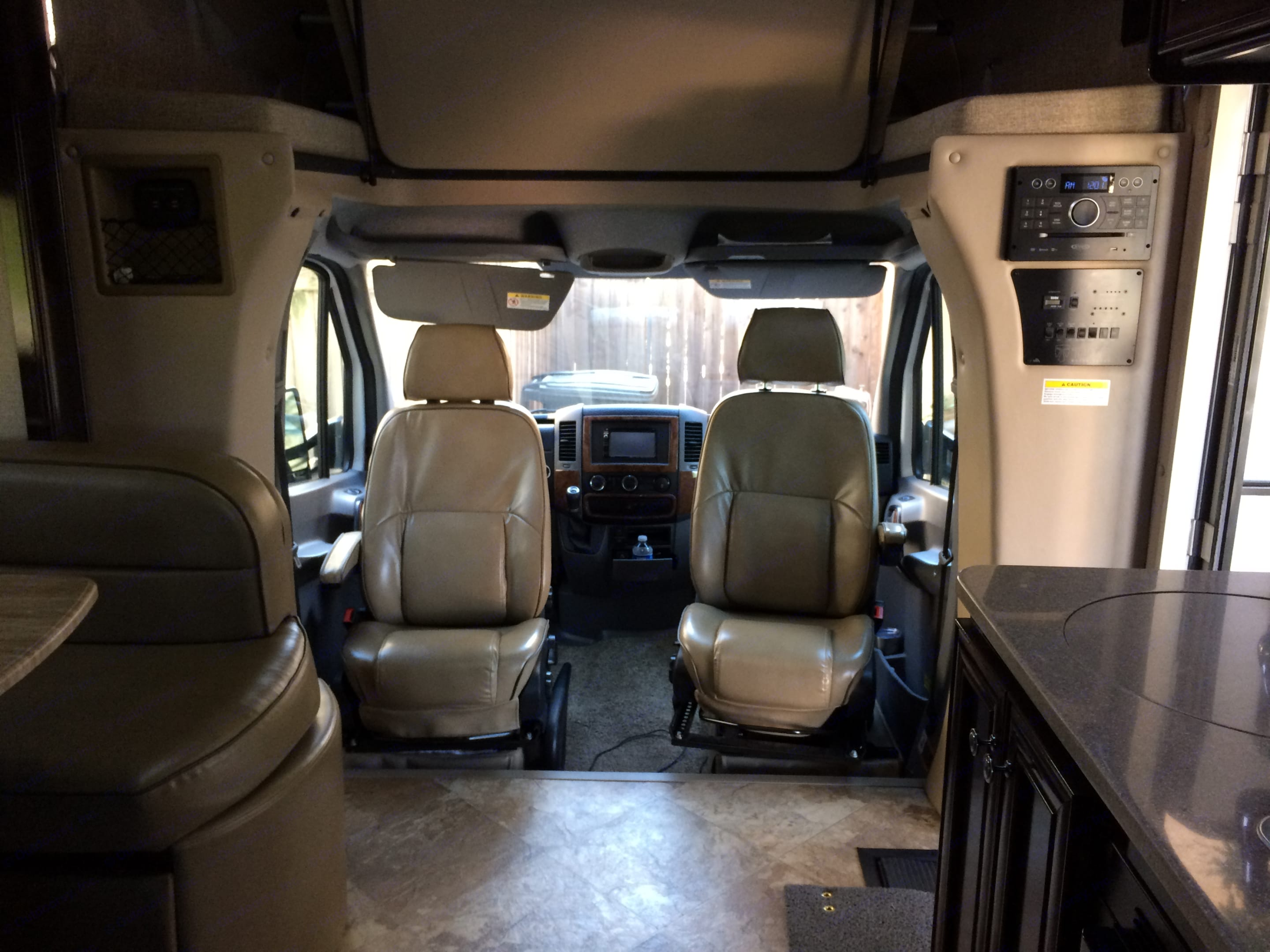 Front seats swivel back to provide more entertainment settings.. Thor Motor Coach Citation 2017