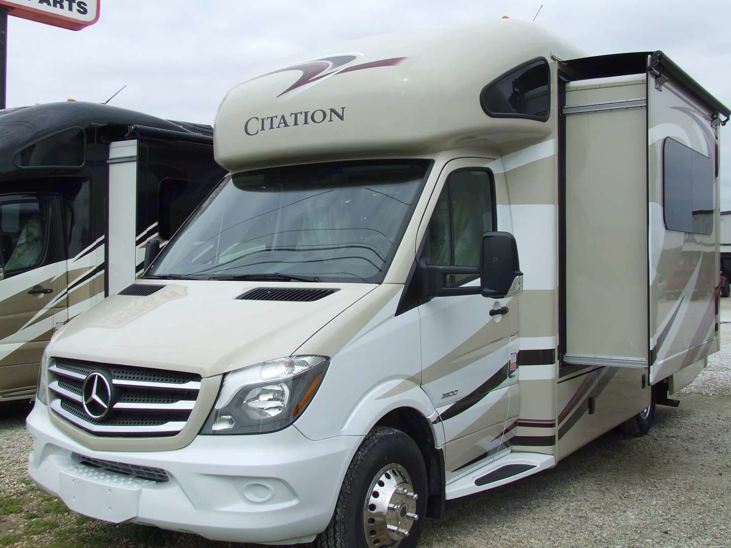 RV exterior with slide extended.. Thor Motor Coach Citation 2017