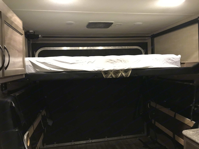 Upper queen bed rear of camper . Pacific Coachworks Sandsport 2017