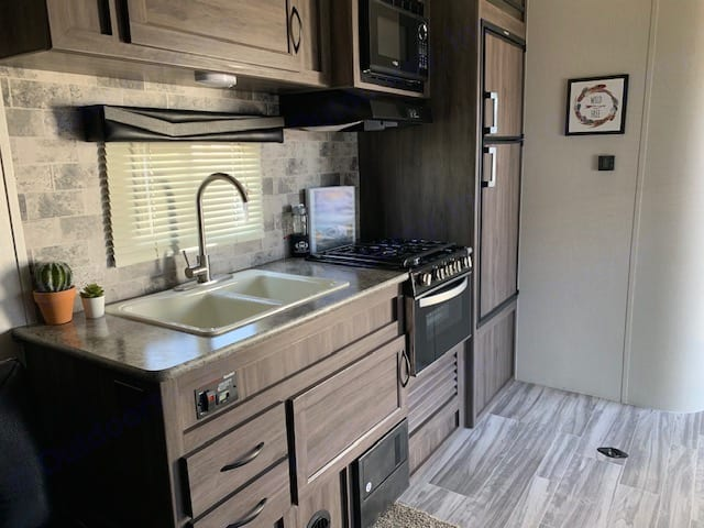 Gorgeous kitchen with everything you need to cook a delicious meal!. Pacific Coachworks Sandsport 2020