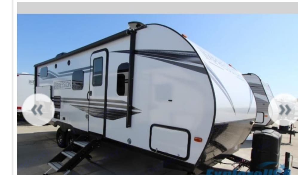 A beautiful Forest River - Impression Travel trailer. Double door with screen, awning comes out to 19', outdoor speakers allows you to feel the music surrounded by the stars and a grill area with cook tops and refrigerator to have everything ready in one spot.. Forest River Impression 2019