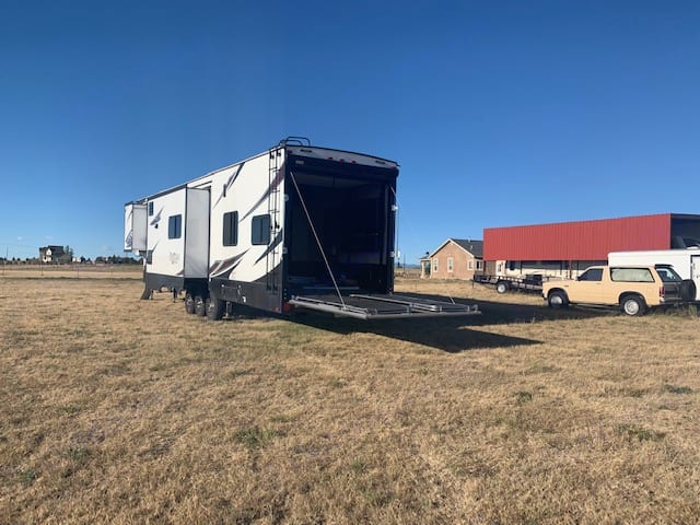 HUGE garage with bunks couches and patio with power awning and LED party lights. Prime Time Spartan 2017