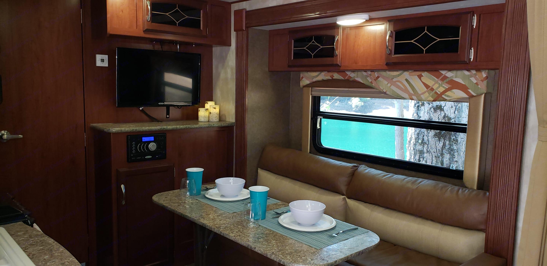 Dining setup and entertainment center. Winnebago Minnie 2015