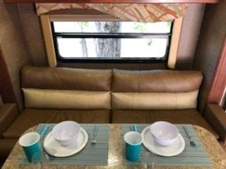 Couch and dining in slide out. Winnebago Minnie 2015