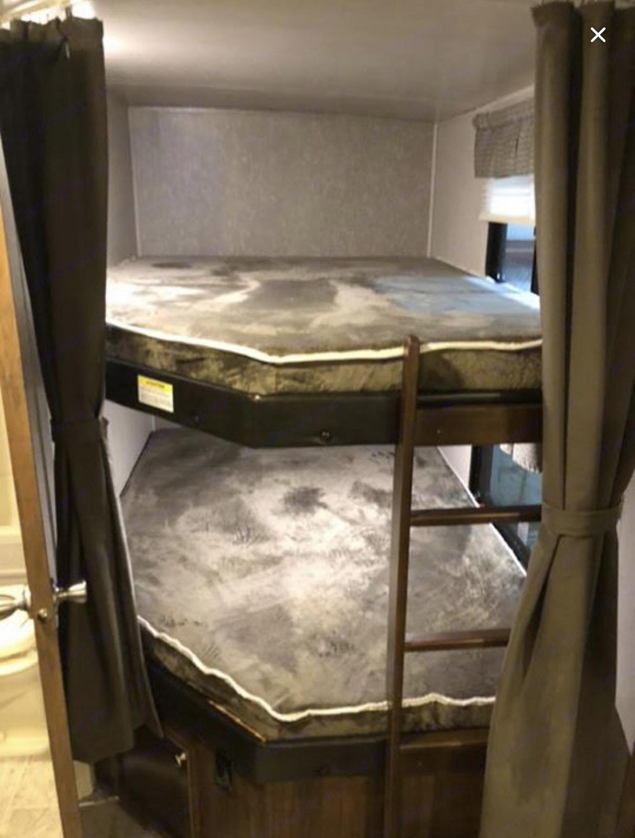 """Bunk beds sleeps a 6'5"""" man comfortably . Heartland Wilderness 2018"""