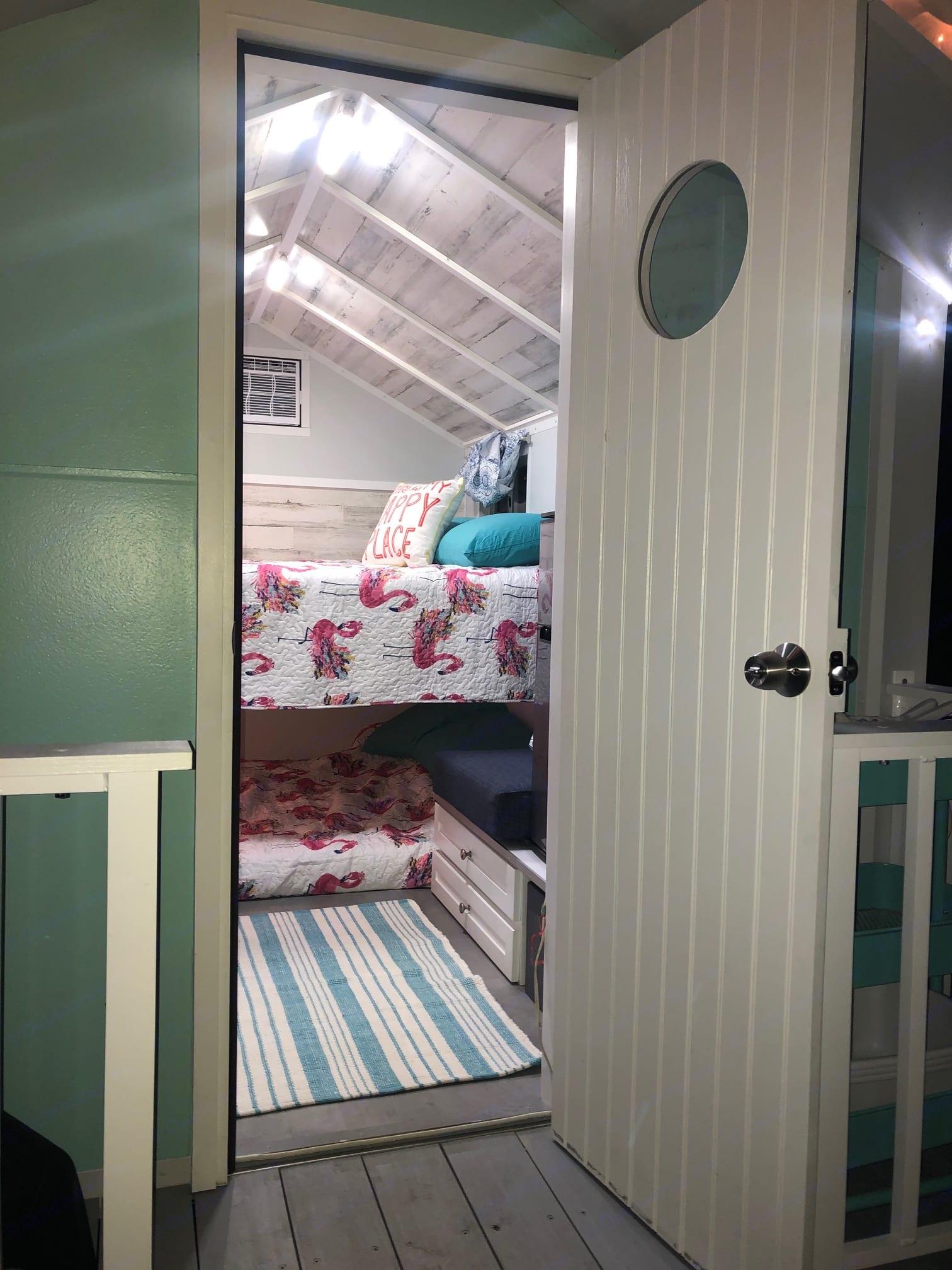 Two Queen memory foam bunk beds, adorable flamingo bedding. Core Housing Solutions Beach House 2019