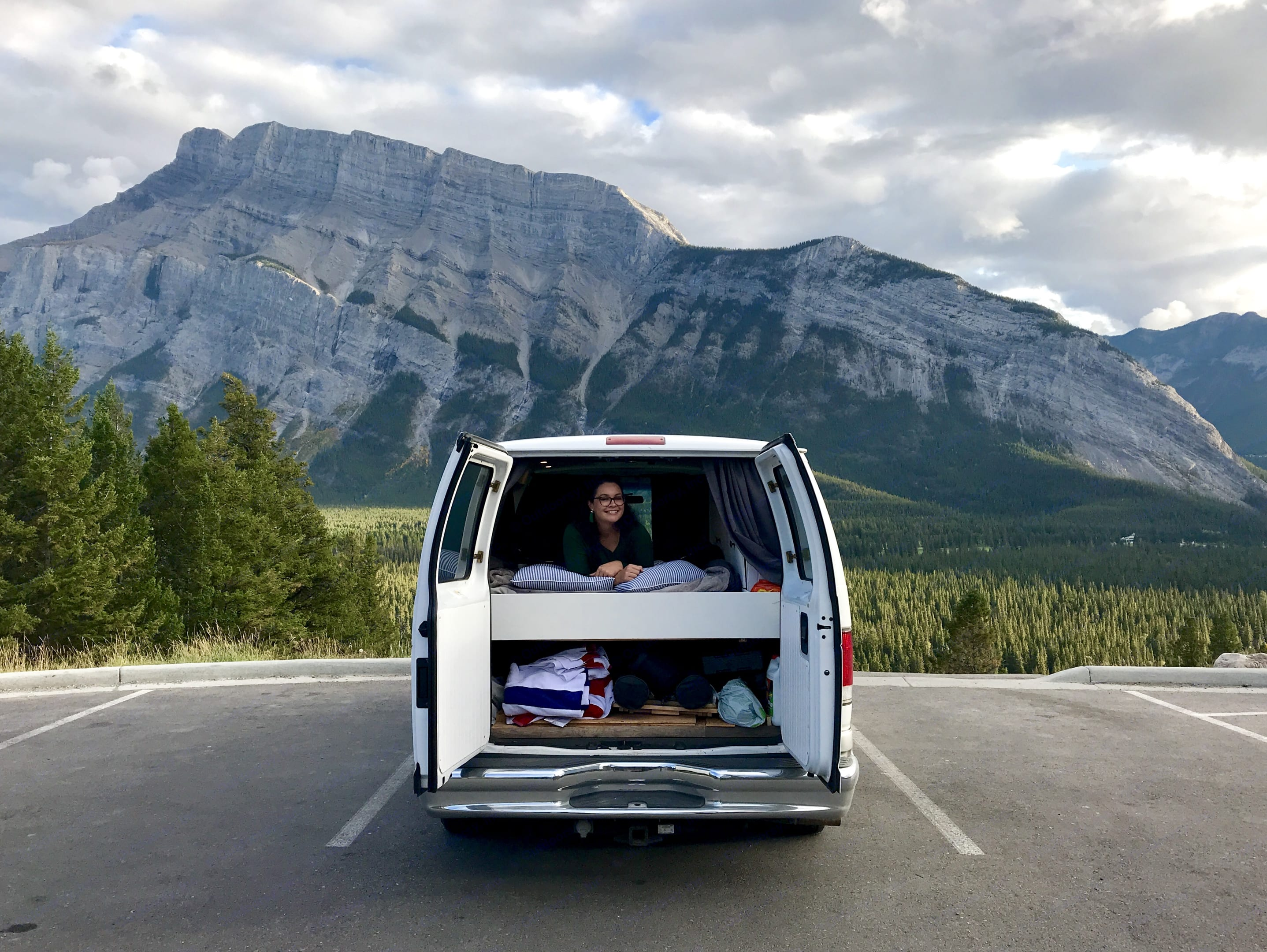 The back of the Van showing the under-bed storage space.. Ford Econoline 150 2000