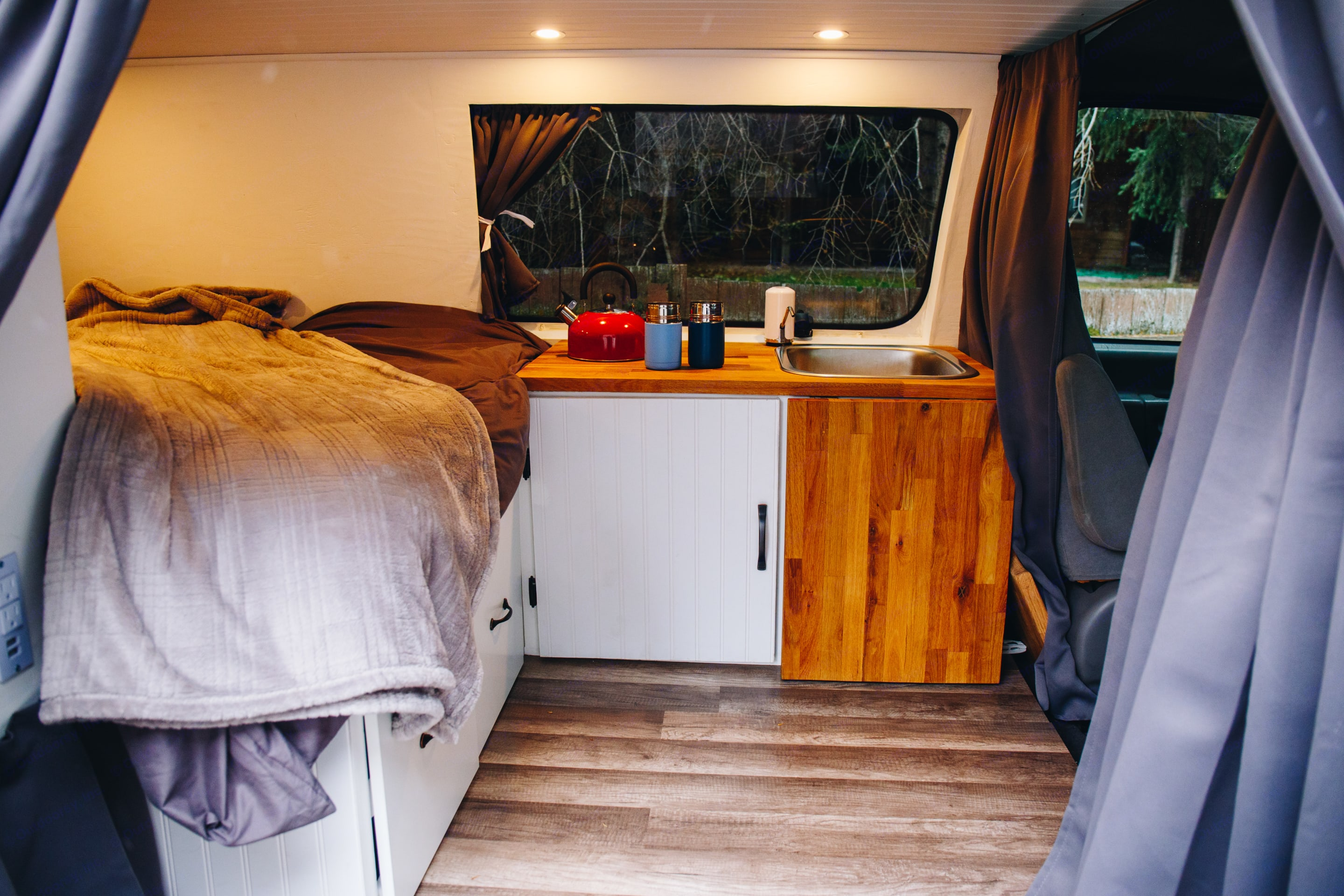 Front of interior of the van showing the kitchen area. Ford Econoline 150 2000