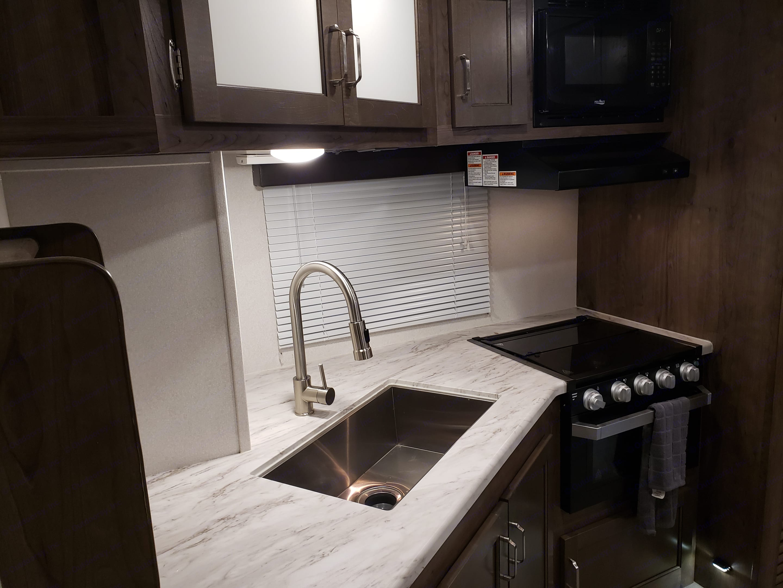 Kitchen w/ ample counter space and storage. Keystone Passport 2600 BHWE 2020