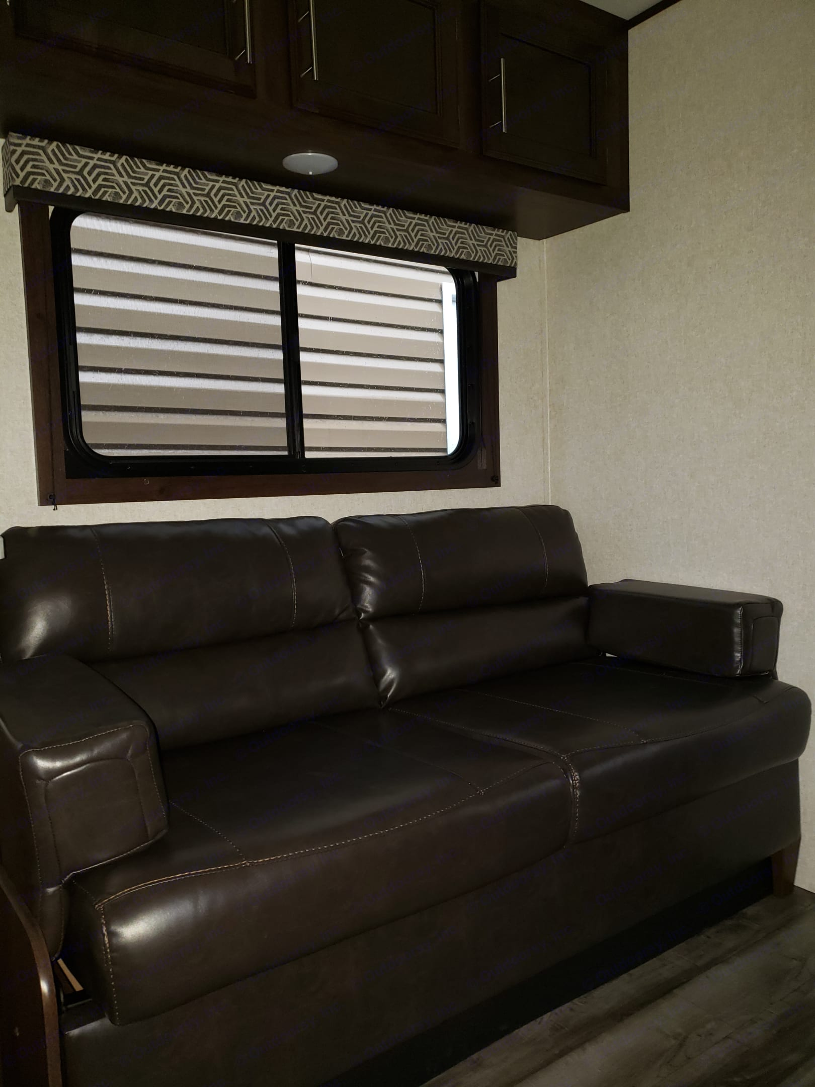 Comfy couch for rainy days with a smart tv, and doubles as an extra bed. Fold out and has extra storage below. . Jayco Flight 2019