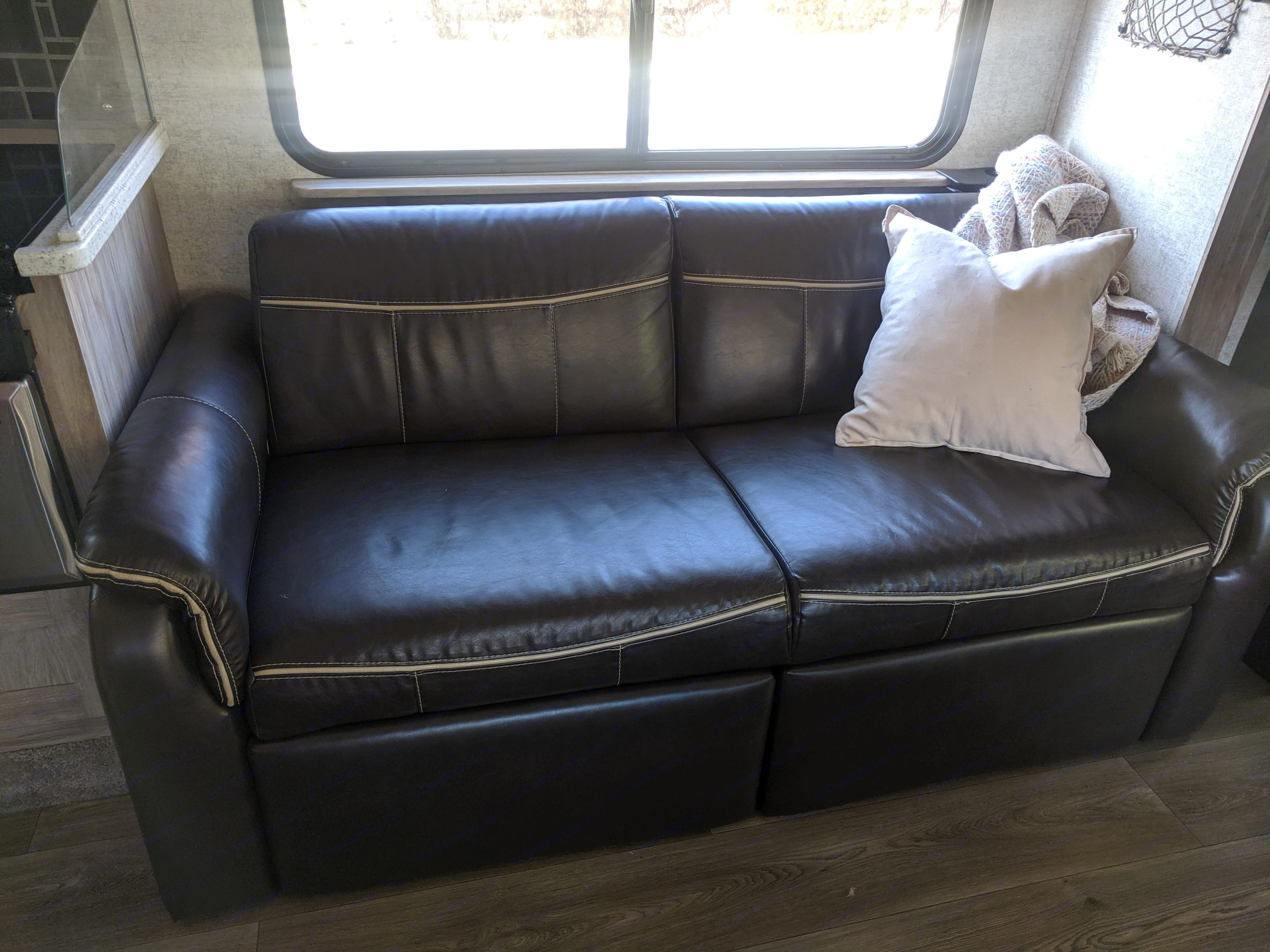 The couch has two recliners built in.. Forest River Forester 2017