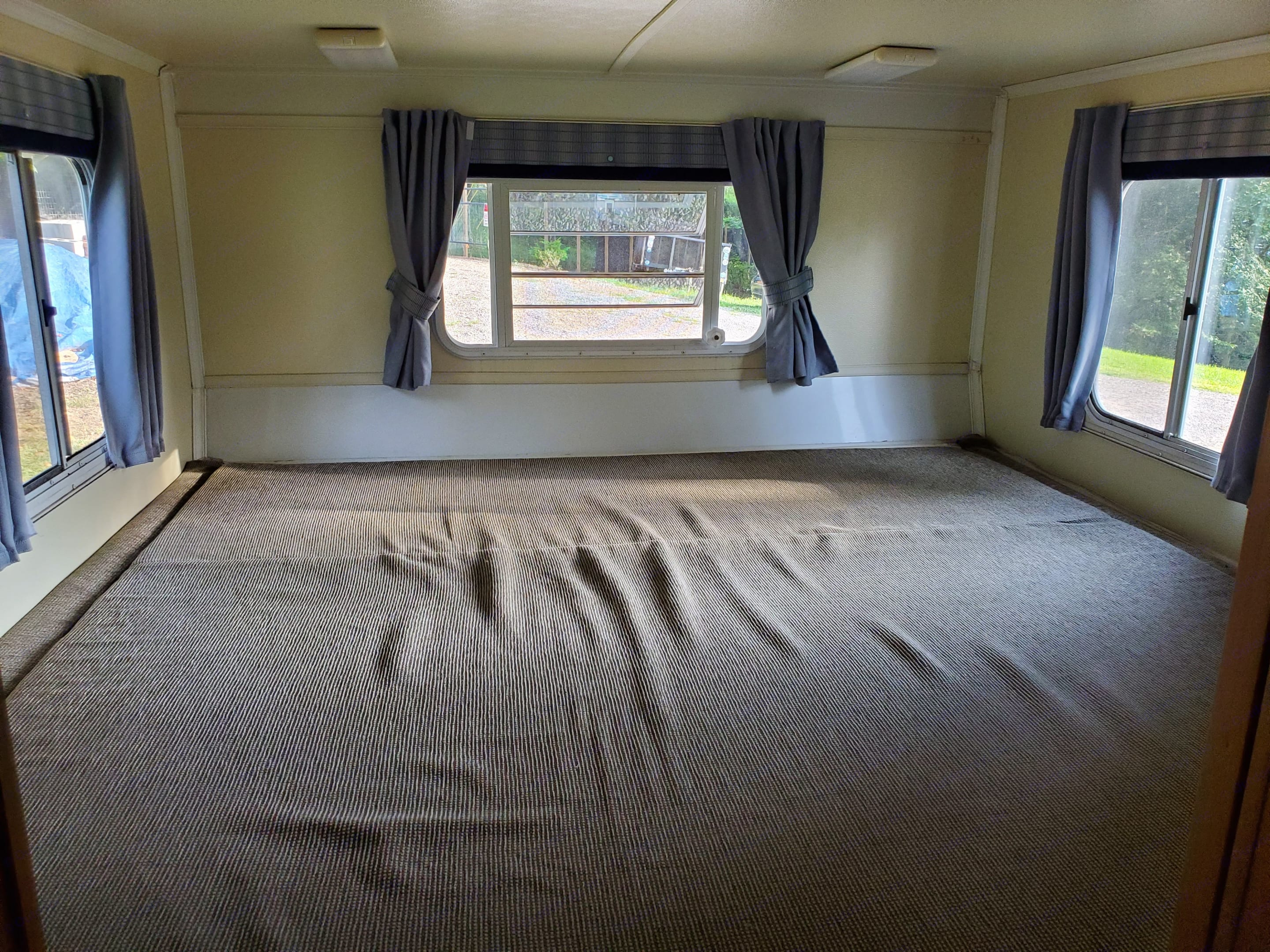King size bed sleeps up to 2 adults and 2 children comfortably. Sheets provided. . Trailmanor 3124ks 2006