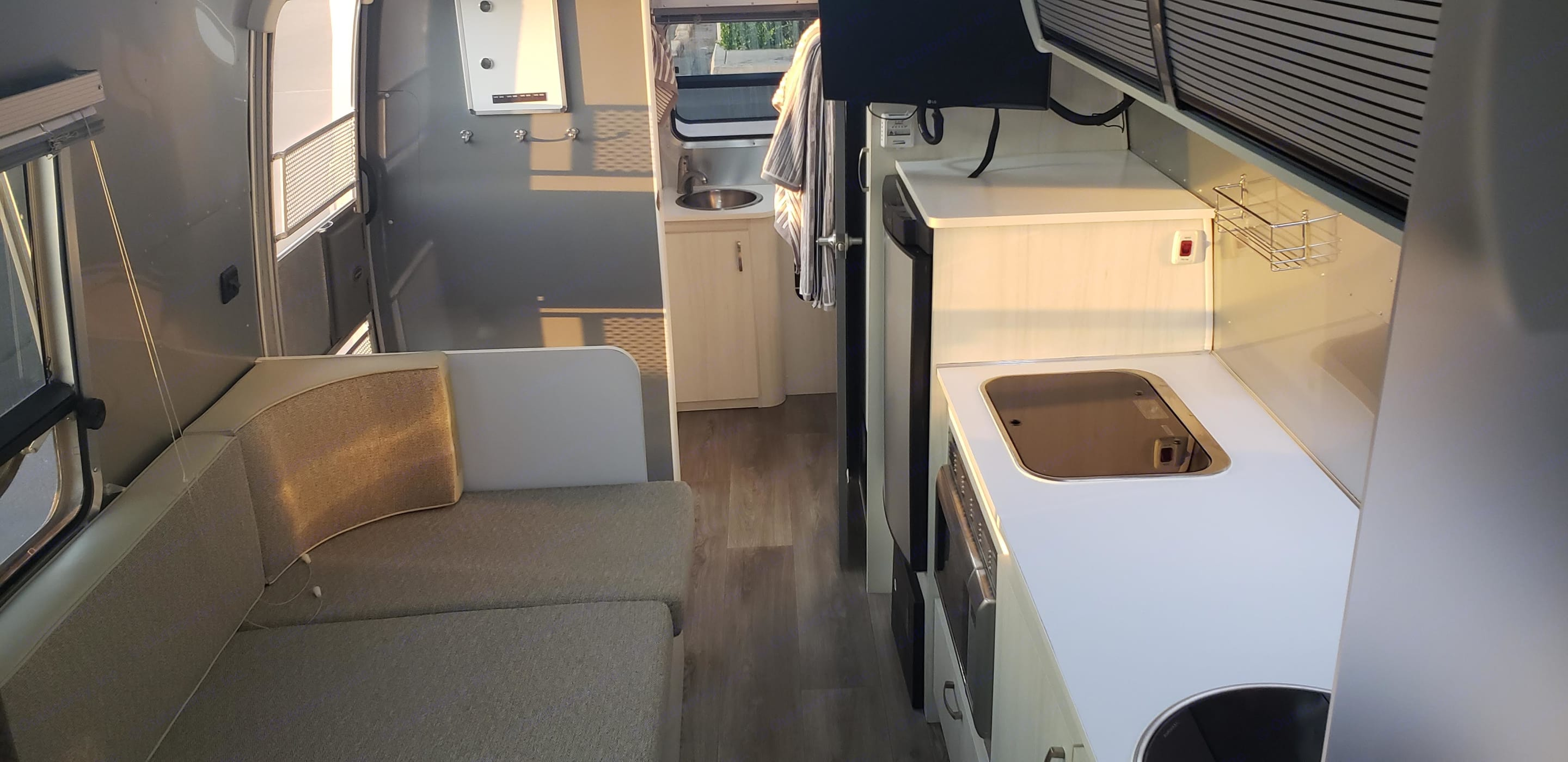Interior looking toward bathroom. Kitchen table converted to twin bed.. Airstream Sport 2016