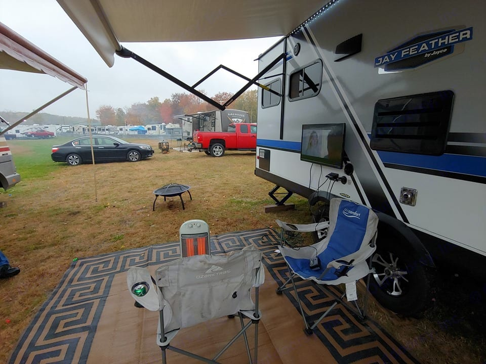 10/24/19 Rainy weather calls for a space heater and tv outside under the awning!. Jayco Jay Feather 2018