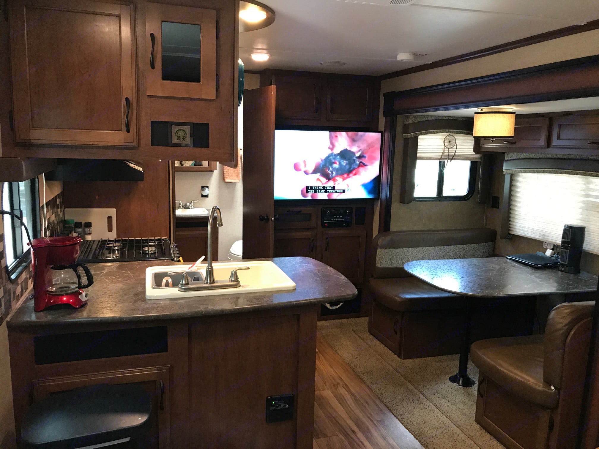 Beautiful Full Kitchen, Countertop, Sink, Stove/Oven, Microwave, Fridge/Freezer, Vent , Drawers/Cabinets, TV (SmartTV), and AM/FM/CD/DVD player with MP3 input and Bluetooth & HDMI connectivity. Jayco Jay Flight 2016